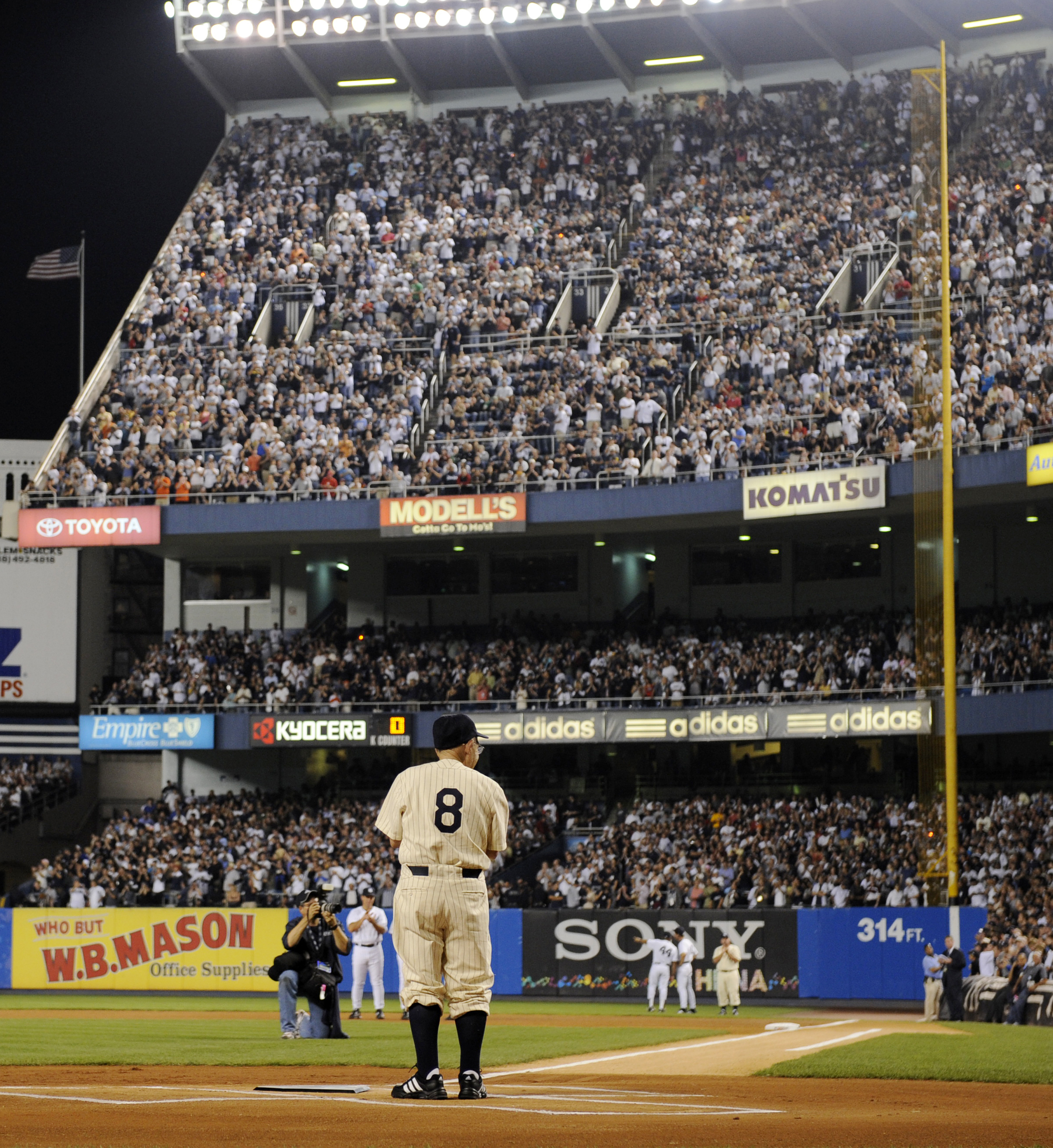 FILE - In this Sept. 21, 2008, file photo, former New York Yankees catcher Yogi Berra stands at home plate at Yankee Stadium in New York, before the Yankees played the Baltimore Orioles in the final regular season baseball game at the stadium. The Hall of