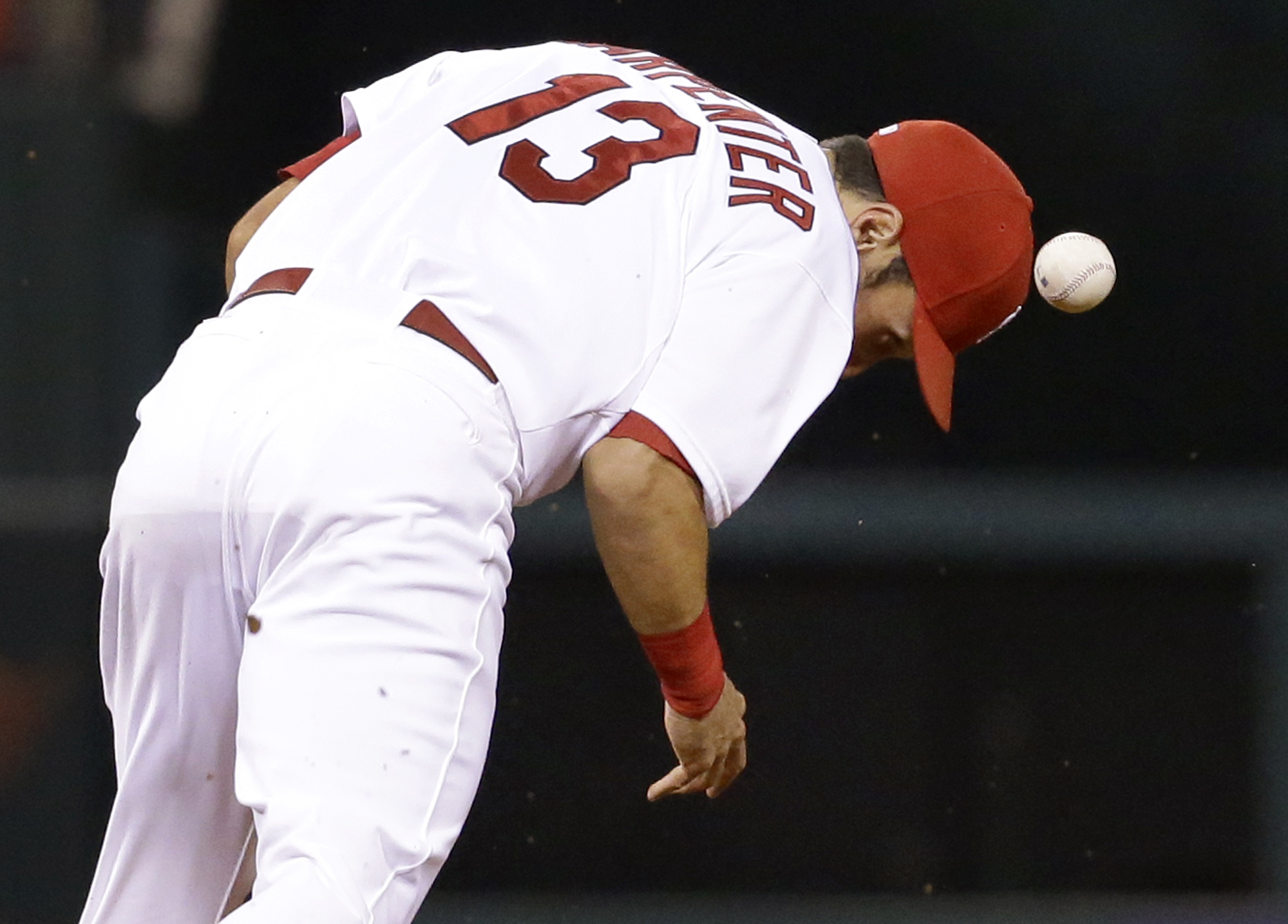 A ball hit for a single by Cincinnati Reds' Joey Votto bounces away from St. Louis Cardinals second baseman Matt Carpenter after it was deflected by Carpenter during the fourth inning of a baseball game on Wednesday, Sept. 23, 2015, in St. Louis. (AP Phot