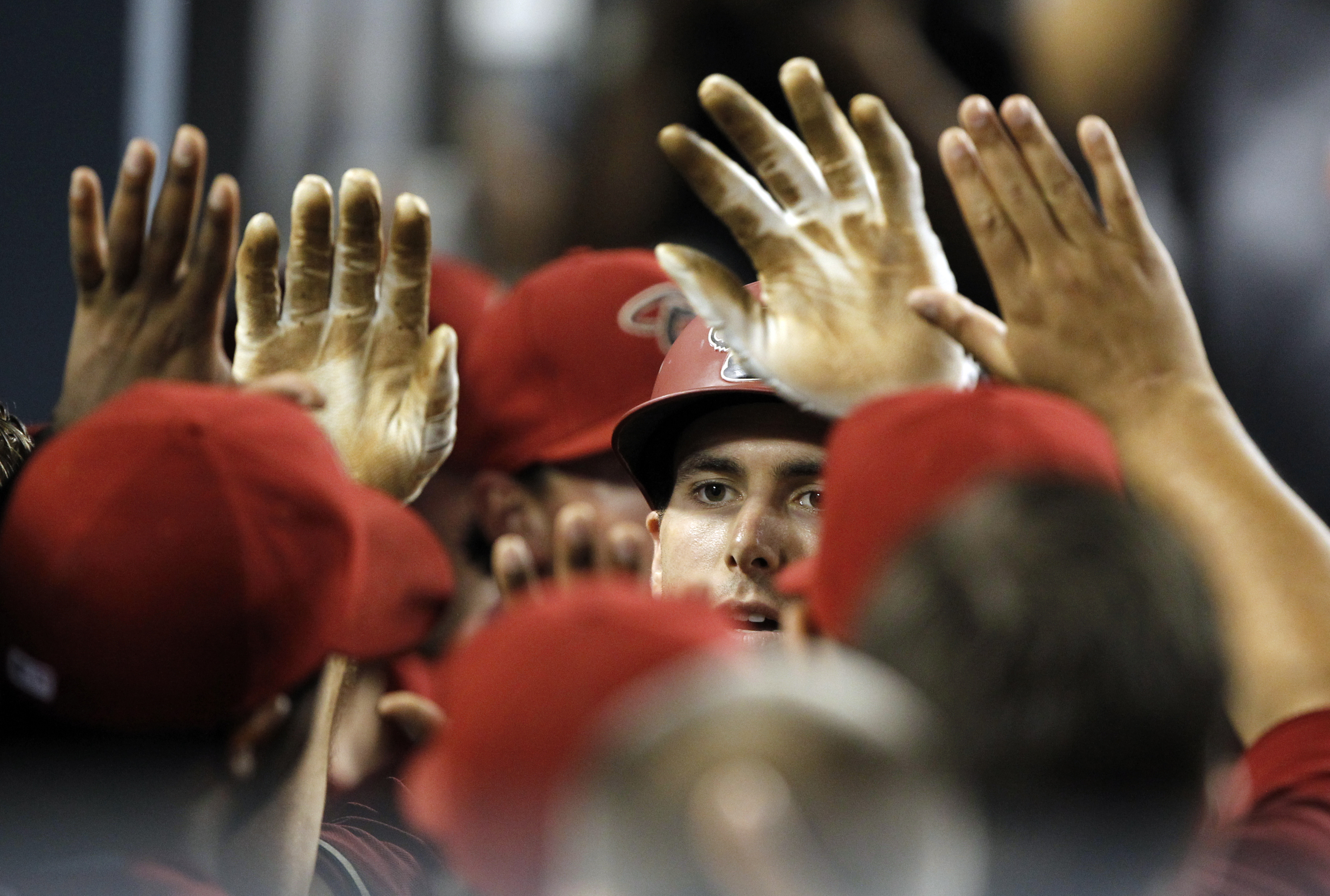 Arizona Diamondbacks' Paul Goldschmidt, center, gets congratulations from teammates after hitting a solo home run against the Los Angeles Dodgers during the second inning of a baseball game in Los Angeles, Wednesday, Sept. 23, 2015. (AP Photo/Alex Gallard