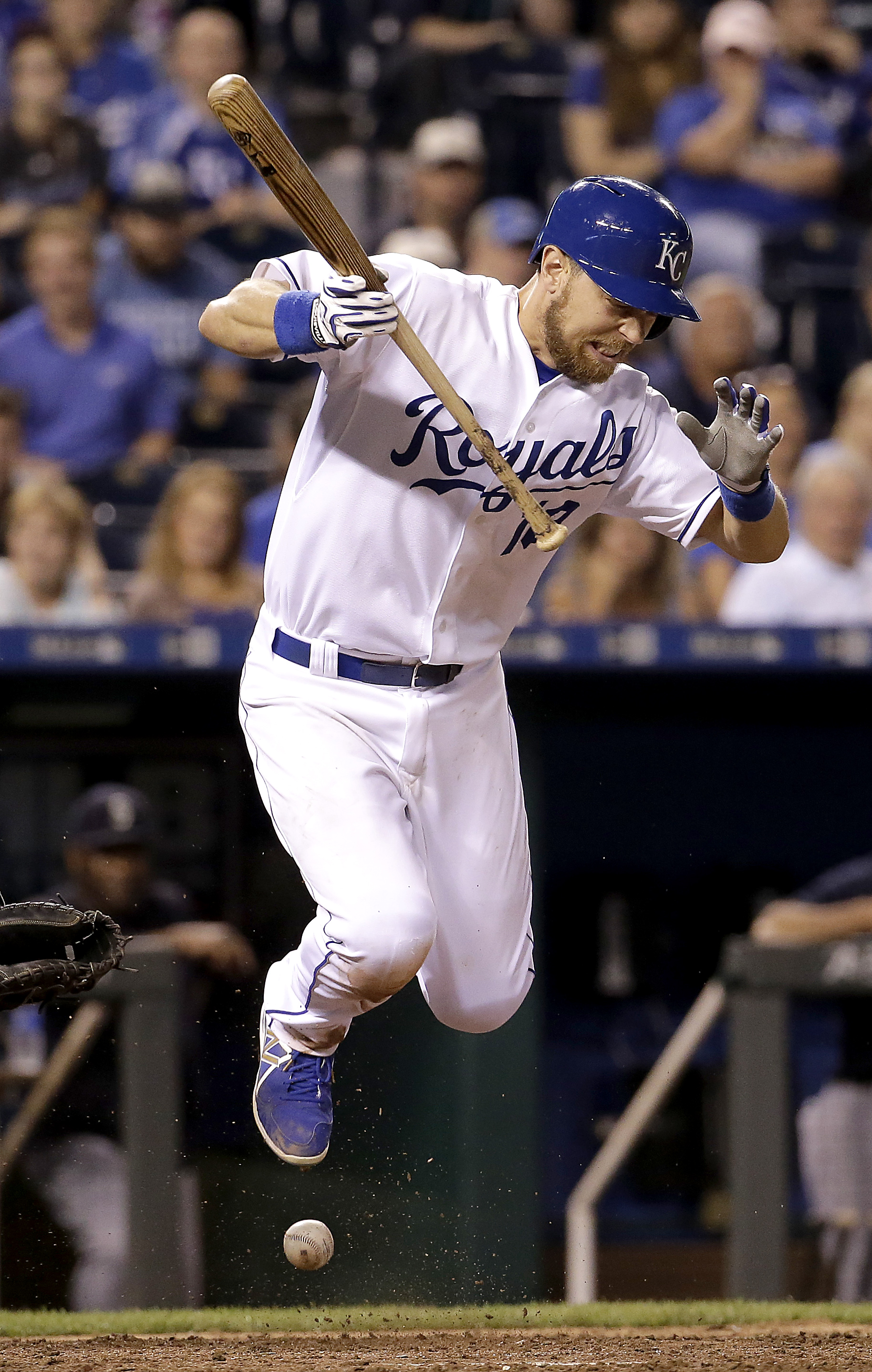 Kansas City Royals' Ben Zobrist is hit by a pitch thrown by Seattle Mariners reliever David Rollins during the 10th inning of a baseball game Wednesday, Sept. 23, 2015, in Kansas City, Mo. (AP Photo/Charlie Riedel)