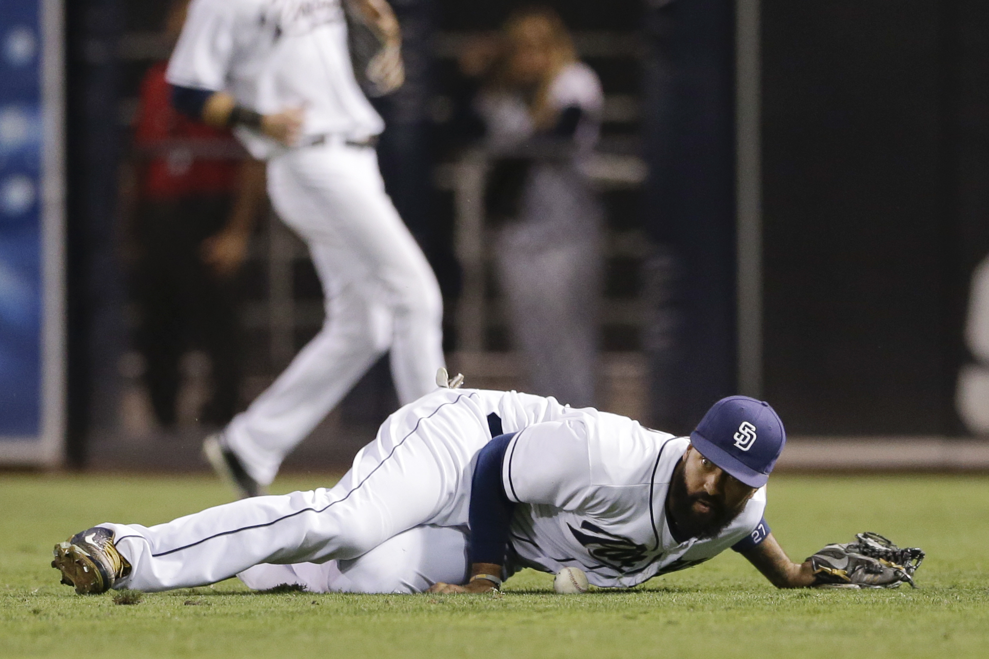 San Diego Padres right fielder Matt Kemp drops the ball hit for a single by San Francisco Giants' Buster Posey during the ninth inning of a baseball game Wednesday, Sept. 23, 2015, in San Diego. Kemp picked up an error on the play. (AP Photo/Gregory Bull)