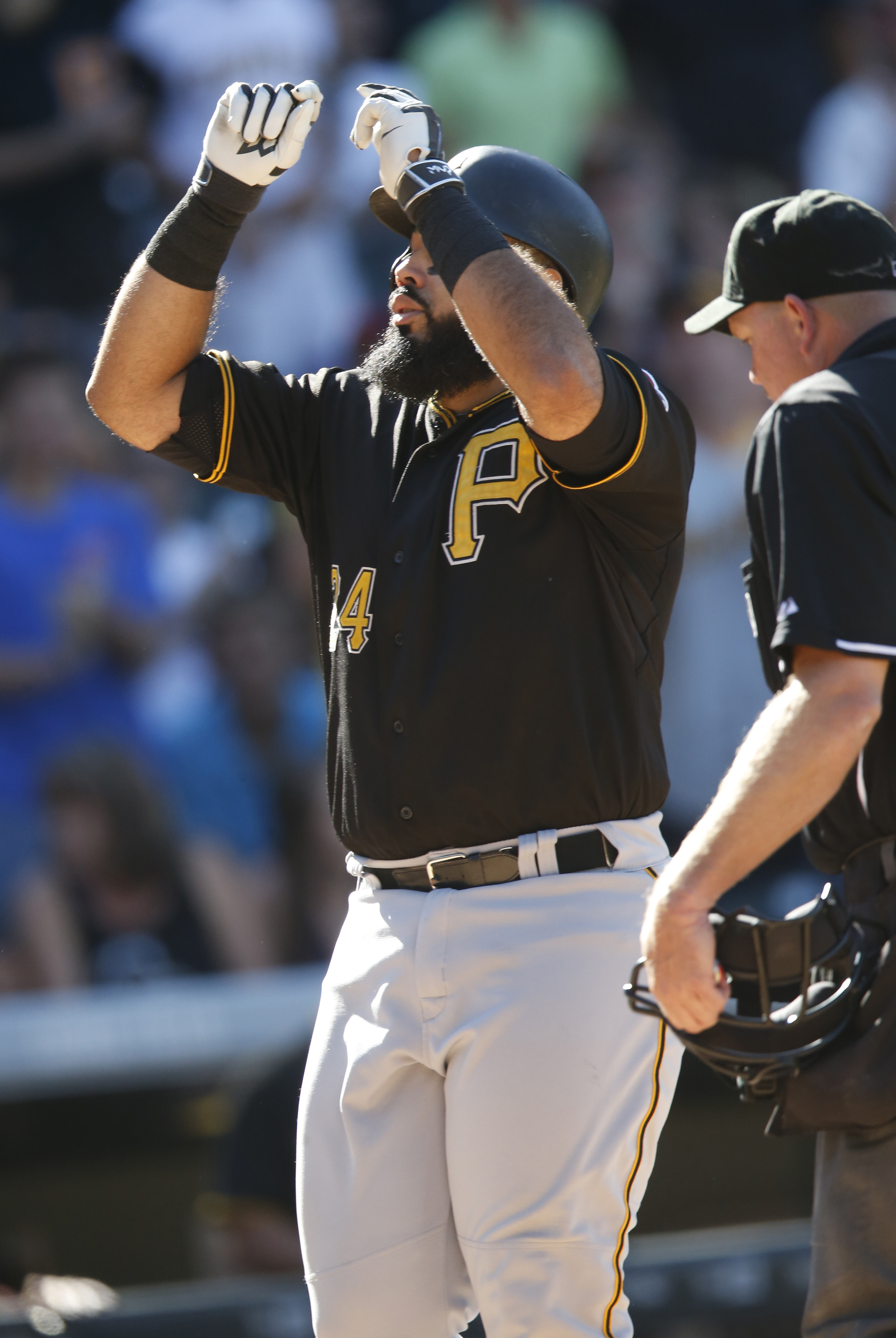 Pittsburgh Pirates' Pedro Alvarez celebrates as he crosses home plate after hitting a three-run home run off Colorado Rockies relief pitcher Jairo Diaz in the eighth inning of a baseball game Thursday, Sept. 24, 2015, in Denver. Pittsburgh won 5-4. (AP Ph