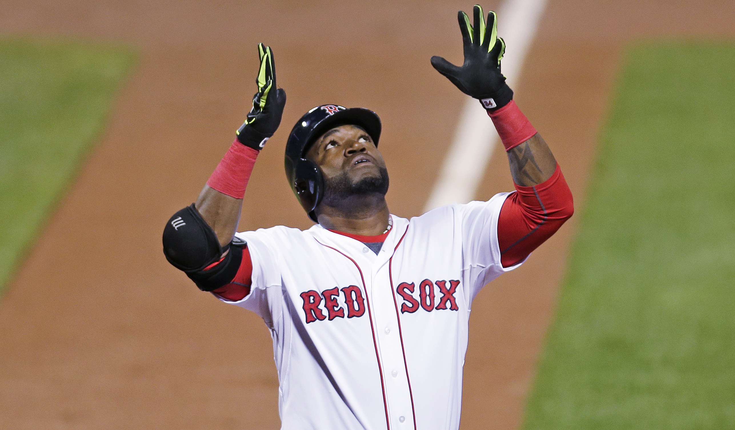 Boston Red Sox designated hitter David Ortiz raises his arms and looks upward as he crosses home plate after a two-run home run during the first inning of a baseball game against the Tampa Bay Rays at Fenway Park in Boston, Thursday, Sept. 24, 2015. (AP P