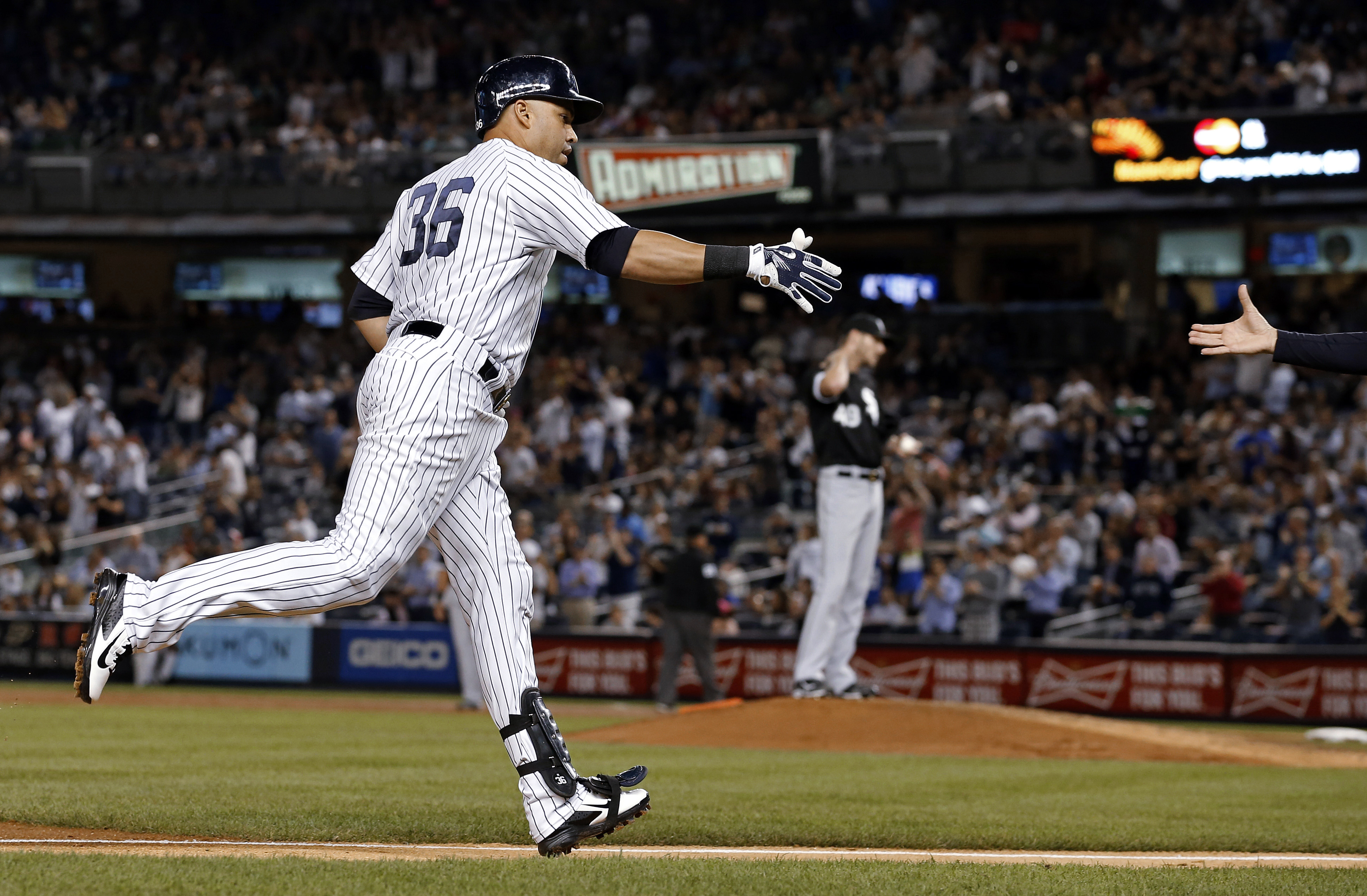 New York Yankees' Carlos Beltran rounds the bases after hitting a three-run home run off of Chicago White Sox starting pitcher Chris Sale during the third inning of a baseball game on Thursday, Sept. 24, 2015, in New York. (AP Photo/Adam Hunger)