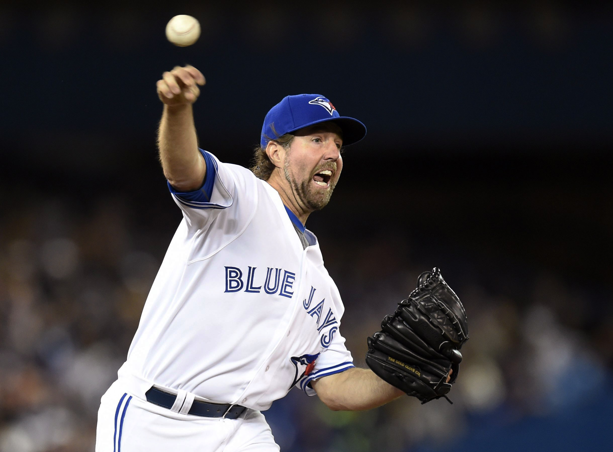 Toronto Blue Jays starting pitcher R.A. Dickey throws to first base during the second inning of a baseball game against the Tampa Bay Rays in Toronto on Friday, Sept. 25, 2015. (Frank Gunn/The Canadian Press via AP)