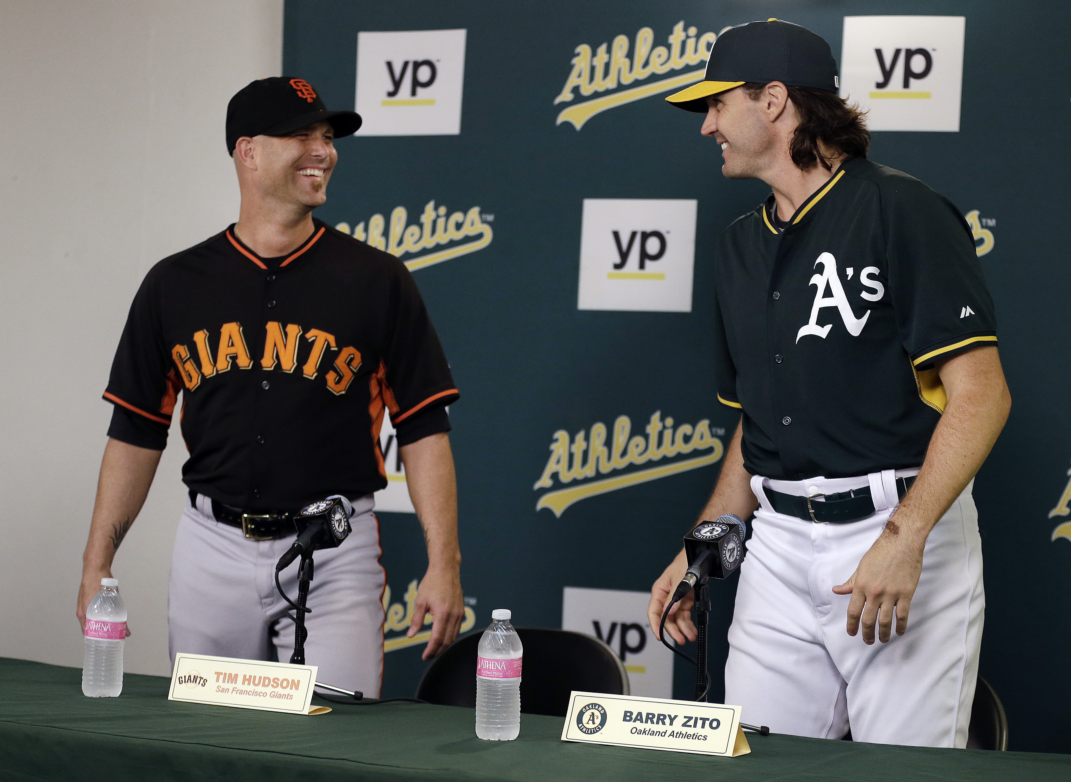 San Francisco Giants pitcher Tim Hudson, left, and Oakland Athletics pitcher Barry Zito smile at each other prior to a news conference before a baseball game Friday, Sept. 25, 2015, in Oakland, Calif. (AP Photo/Ben Margot)