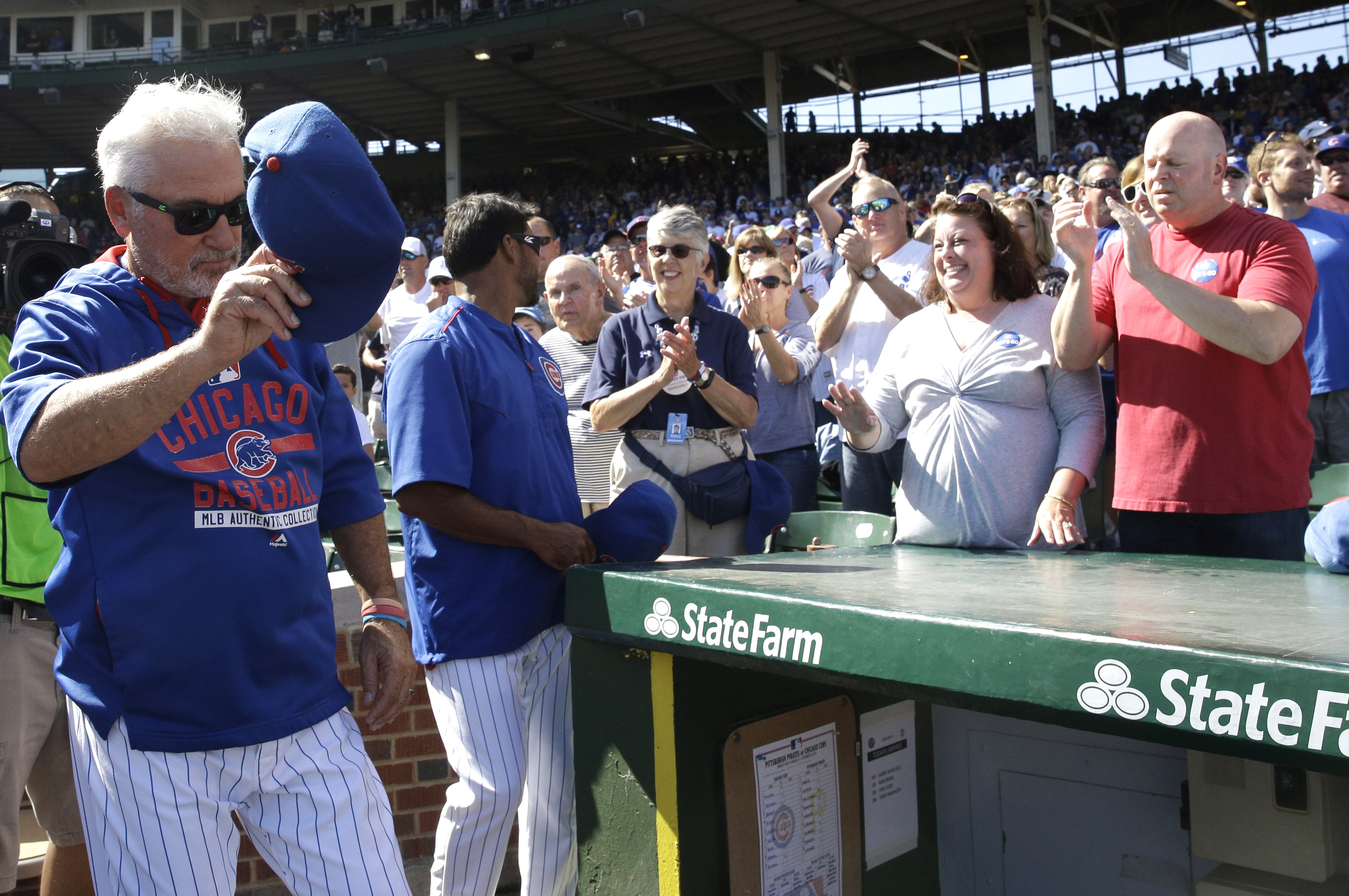 Chicago Cubs manager Joe Maddon acknowledges the crowd before a baseball game against the Pittsburgh Pirates, Saturday, Sept. 26, 2015, in Chicago. (AP Photo/Nam Y. Huh)