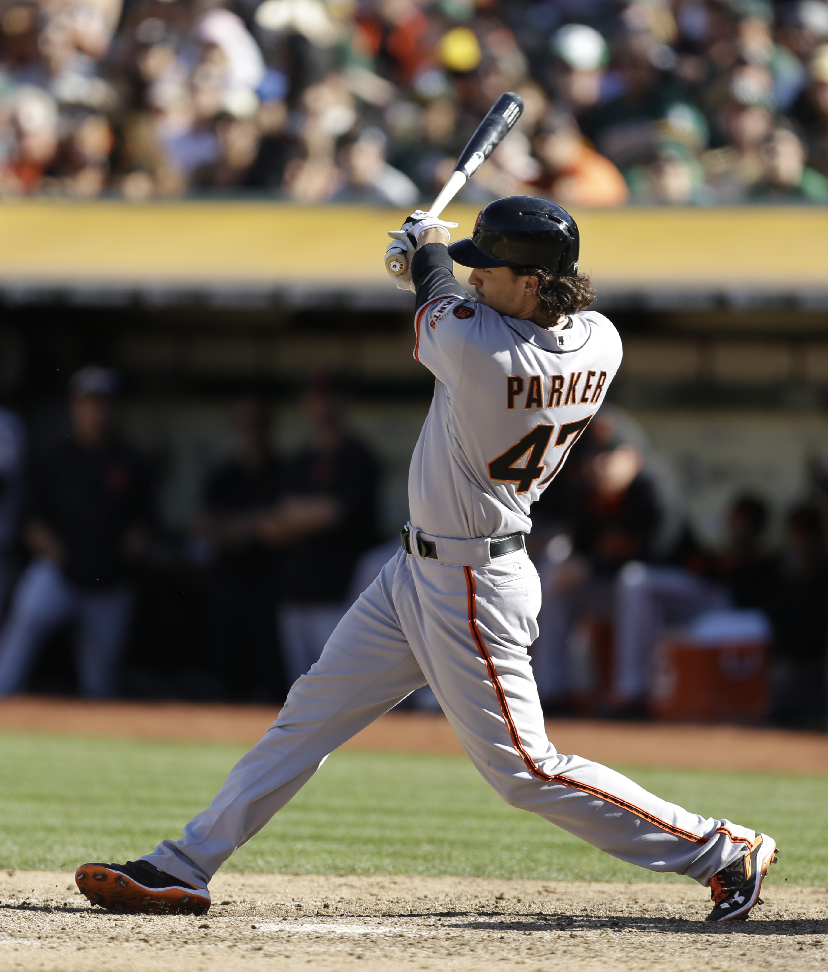 San Francisco Giants' Jarrett Parker swings for a grand slam off Oakland Athletics' Ryan Dull in the eighth inning of a baseball game Saturday, Sept. 26, 2015, in Oakland, Calif. (AP Photo/Ben Margot)