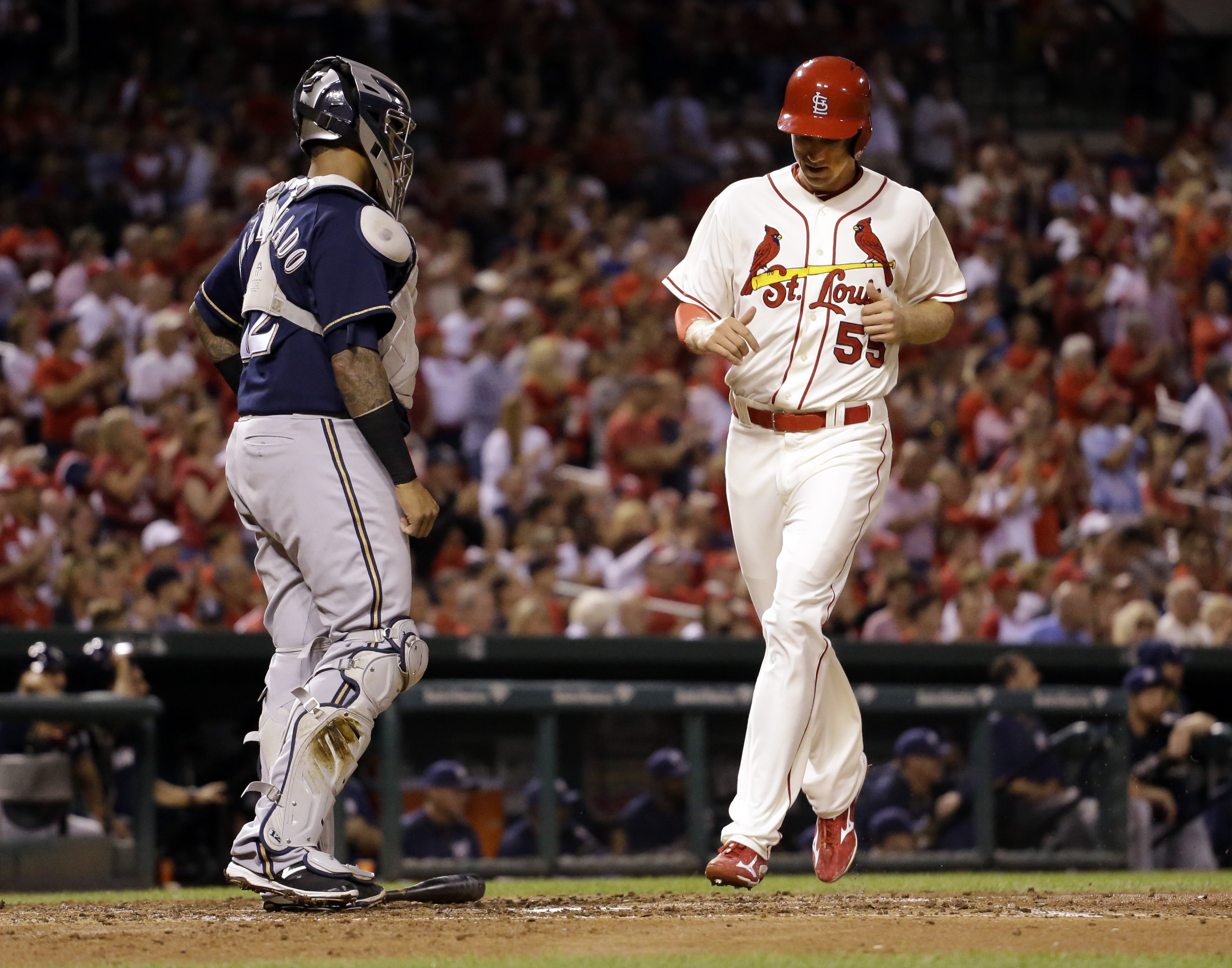 St. Louis Cardinals' Stephen Piscotty, right, scores past Milwaukee Brewers catcher Martin Maldonado on a double by Matt Holliday during the second inning of a baseball game on Saturday, Sept. 26, 2015, in St. Louis. (AP Photo/Jeff Roberson)