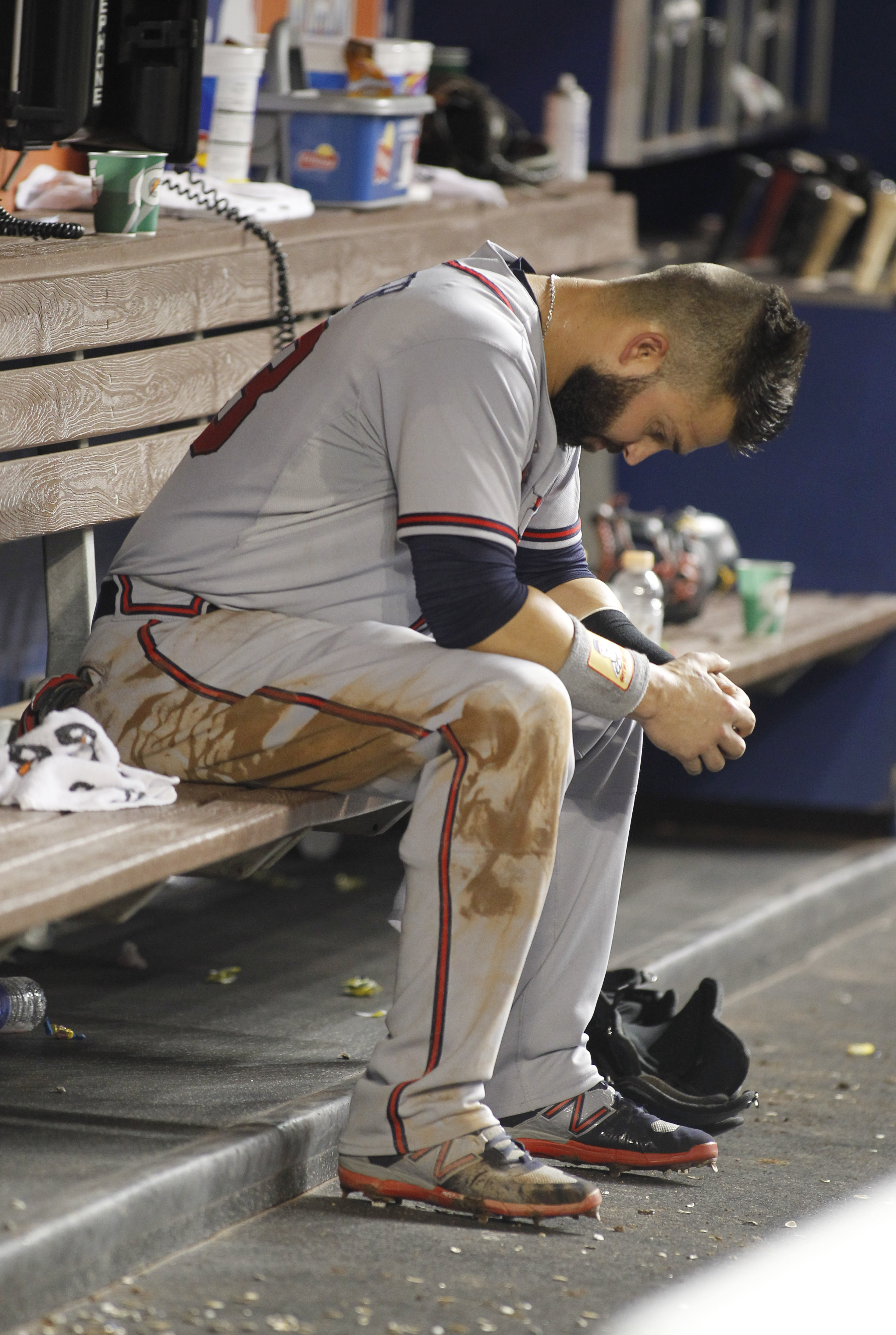Atlanta Braves left fielder Nick Swisher (23) reacts in the dugout after he was tagged out at second base in the fourth inning of play against the Miami Marlins during a baseball game in Miami, Saturday, Sept. 26, 2015. (AP Photo/Joe Skipper)