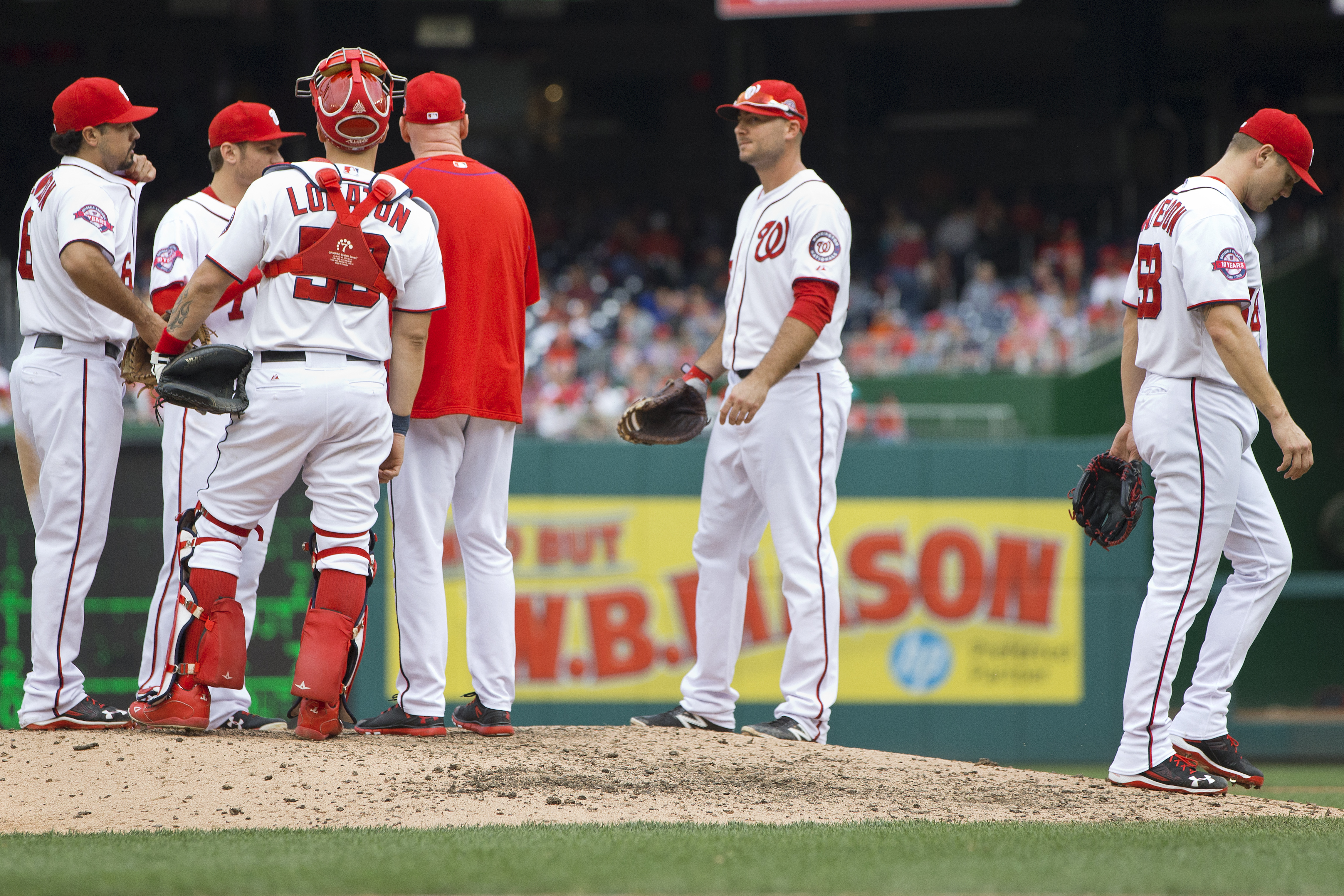 Washington Nationals relief pitcher Jonathan Papelbon (58) walks off the mound as he is relieved in the ninth inning of a baseball game against the Philadelphia Phillies at Nationals Park in Washington, Sunday, Sept. 27, 2015. Papelbon got into a dugout f