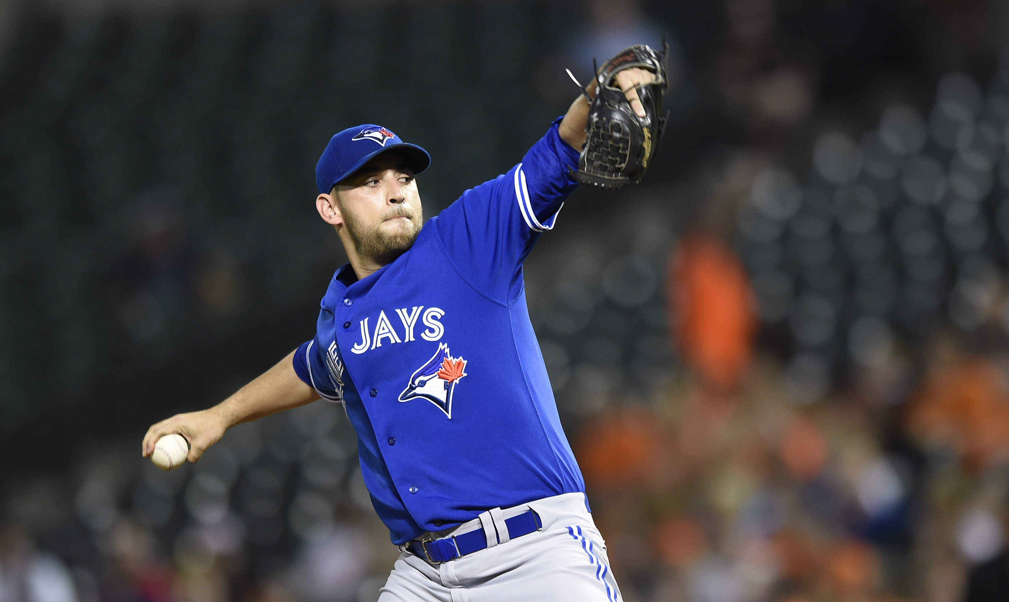 Toronto Blue Jays starting pitcher Marco Estrada delivers against the Baltimore Orioles in the first inning of a baseball game, Monday, Sept. 28, 2015, in Baltimore. (AP Photo/Gail Burton)