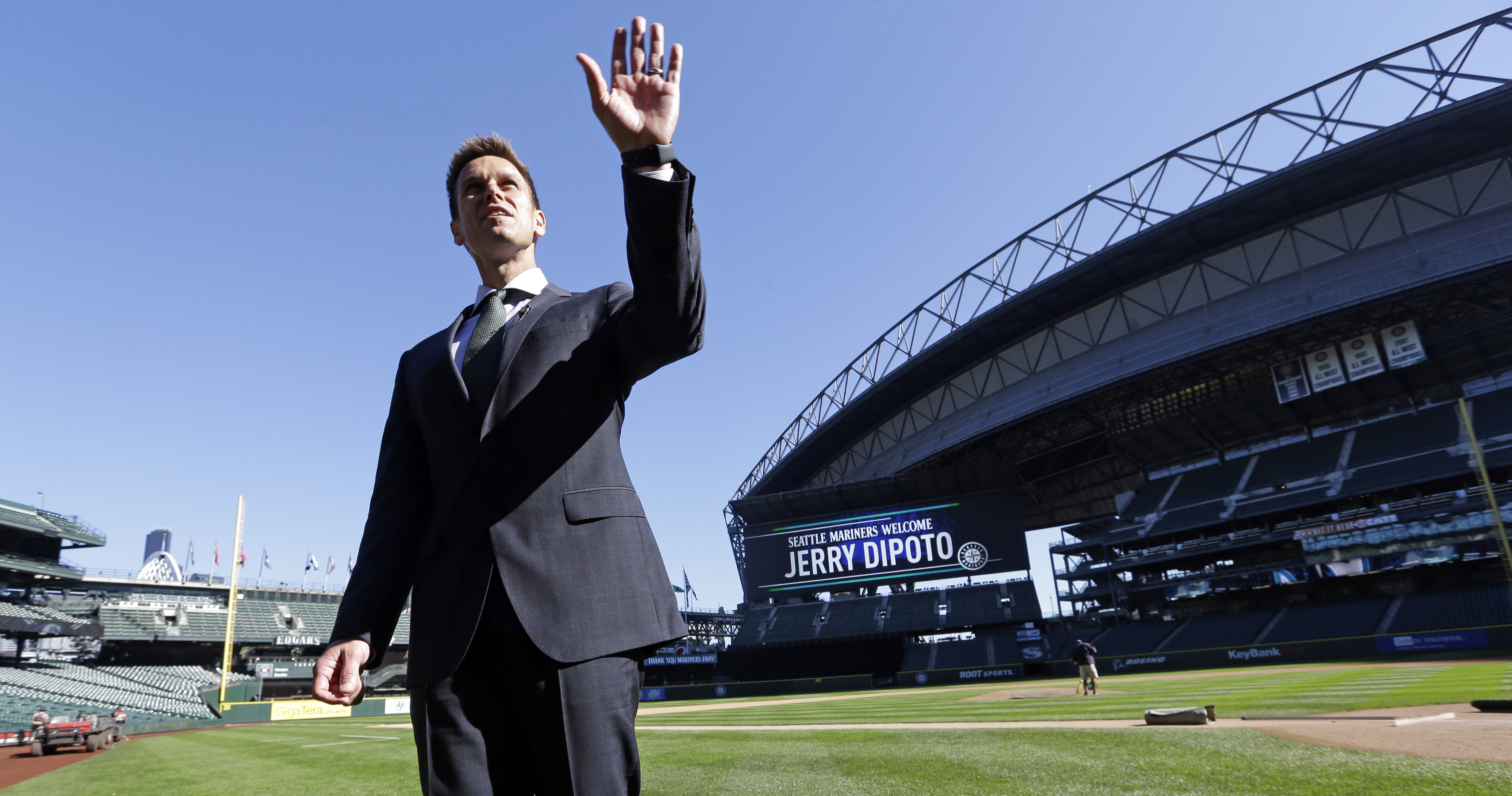 New Seattle Mariners general manager Jerry Dipoto motions toward the upper deck of the team's ballpark as he stands on the field after a news conference Tuesday, Sept. 29, 2015, in Seattle. For Dipoto, being hired by the Mariners as their new general mana