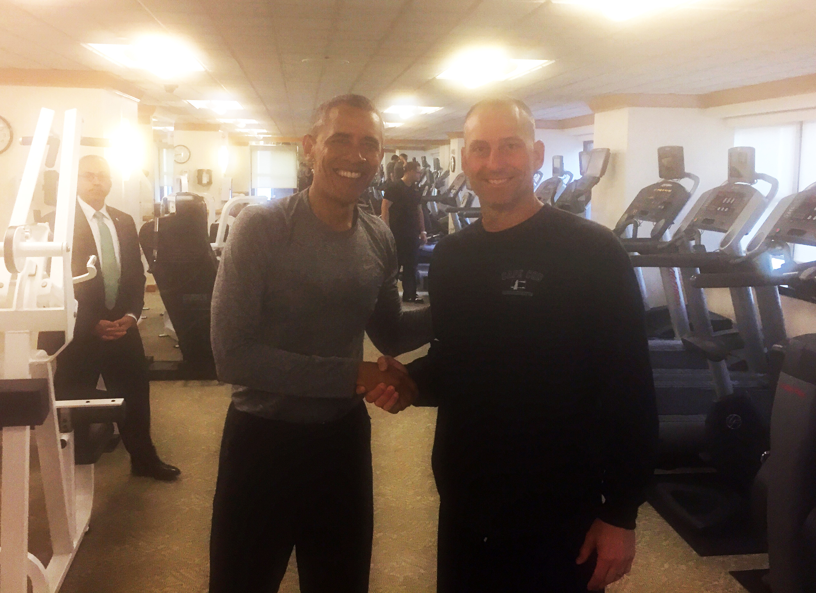 In this photo provided by the Boston Red Sox, President Barack Obama, left, shakes hands with Boston Red Sox Interim Manager Torey Lovullo in the exercise room of the New York Palace Hotel, Tuesday, Sept. 29, 2015, in New York. (Mike Hazen/Boston Red Sox