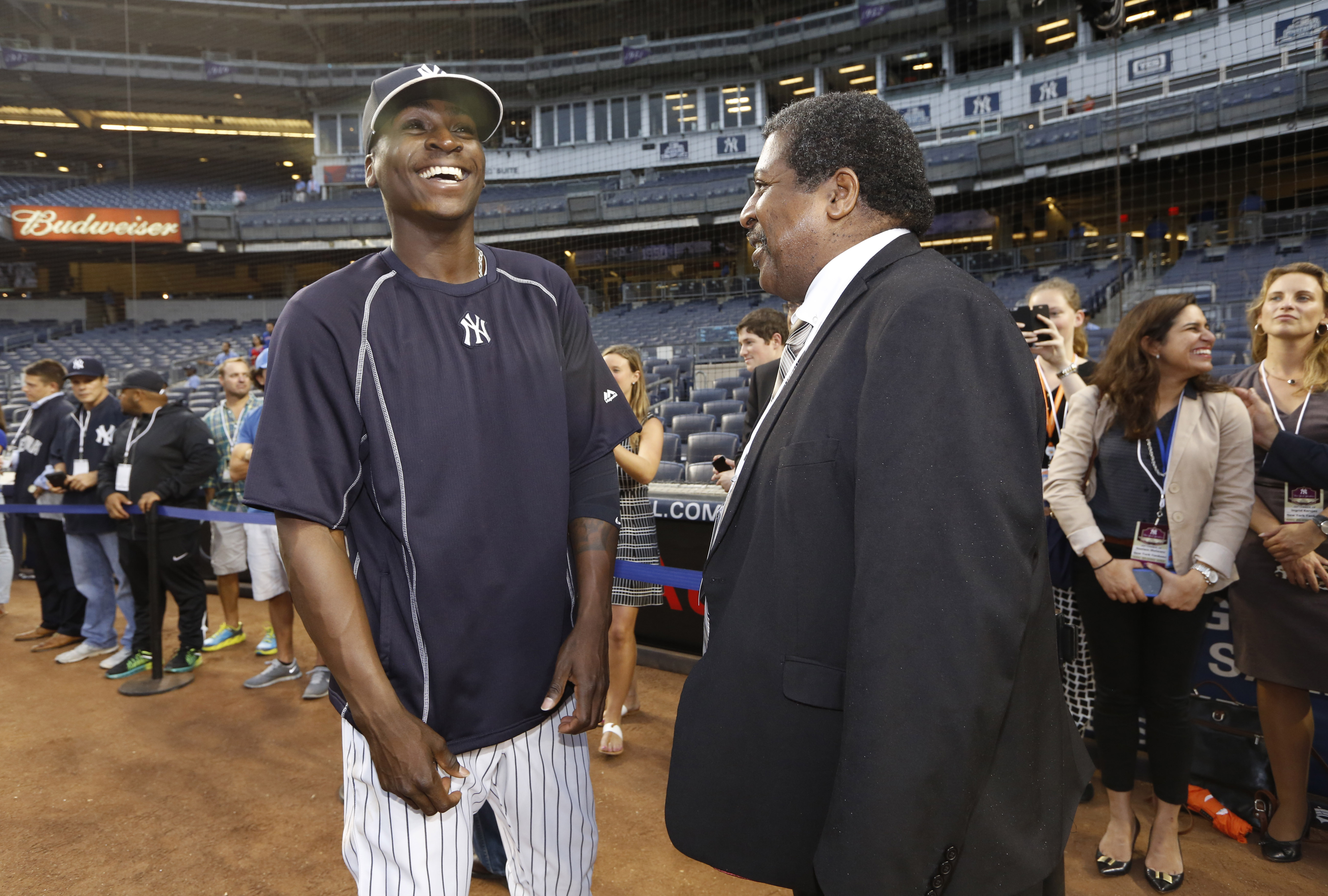 New York Yankees shortstop Didi Gregorius, left, of Curacao, meets Curacao Prime Minister Ben Whiteman on the field before a baseball game against the Boston Red Sox at Yankee Stadium in New York, Tuesday, Sept. 29, 2015. Whiteman is in New york attending