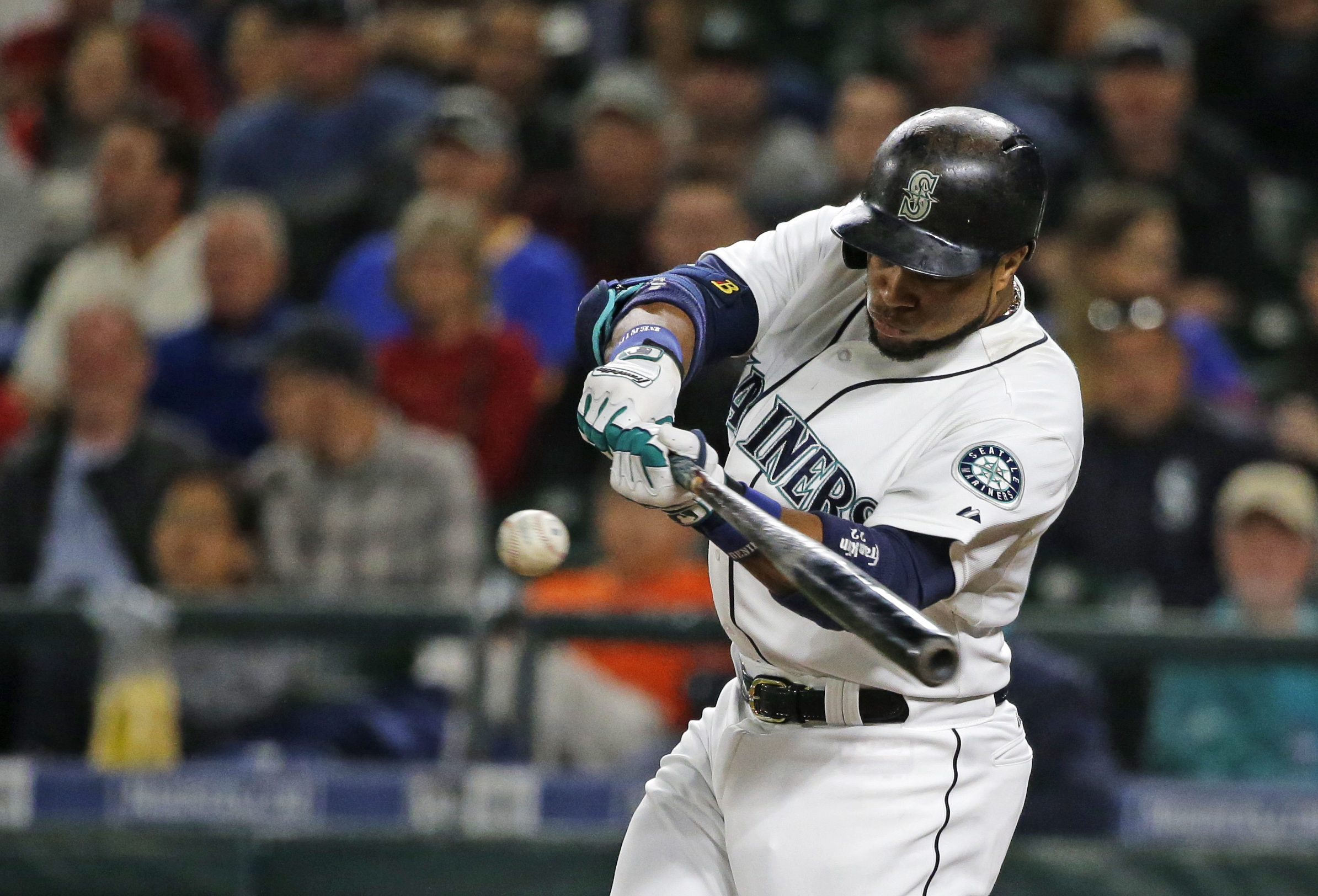 Seattle Mariners' Robinson Cano hits a sacrifice fly to score Kyle Seager in the first inning of a baseball game against the Houston Astros, Tuesday, Sept. 29, 2015, in Seattle. (AP Photo/Ted S. Warren)