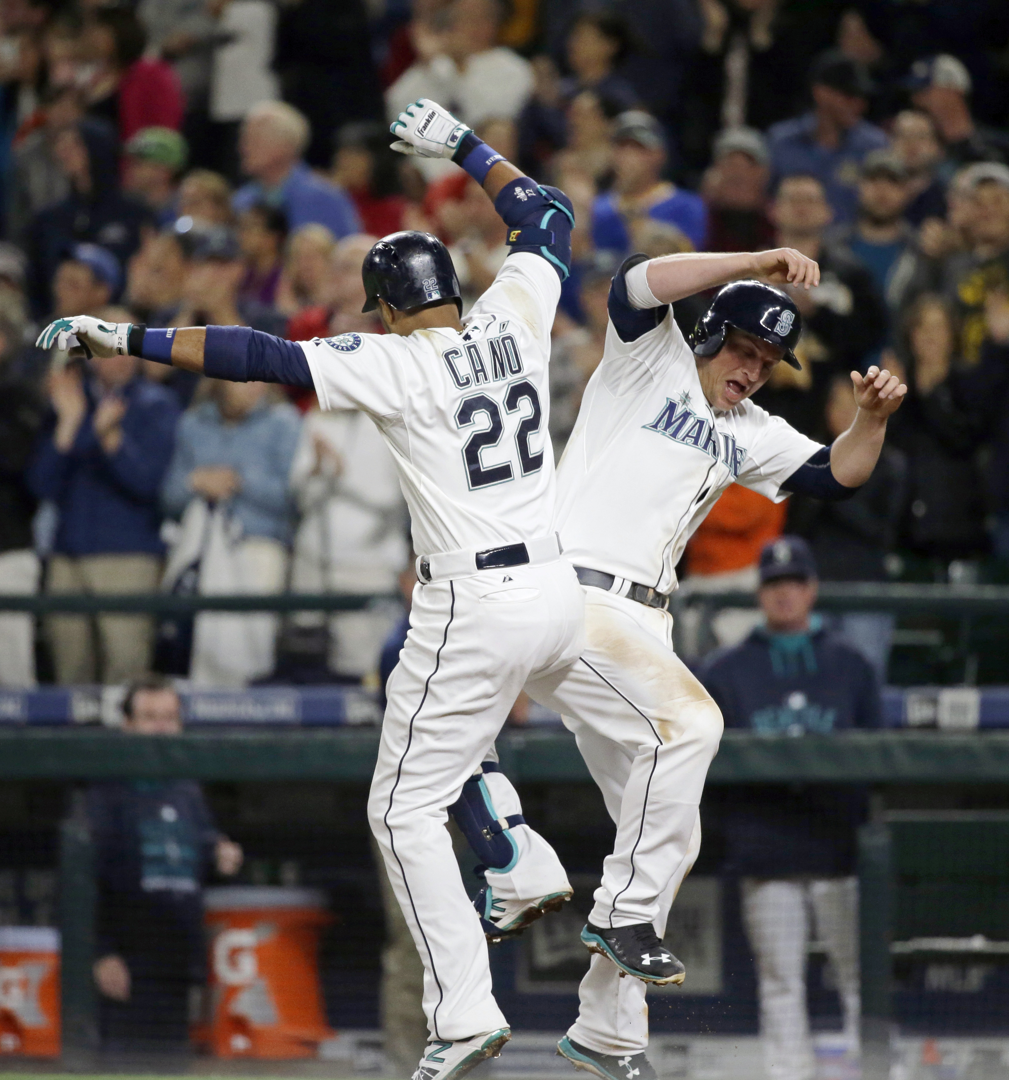Seattle Mariners' Robinson Cano (22) and Kyle Seager, right, celebrate after Cano hit a two-run home run to score Seager in the sixth inning of a baseball game against the Houston Astros, Tuesday, Sept. 29, 2015, in Seattle. (AP Photo/Ted S. Warren)