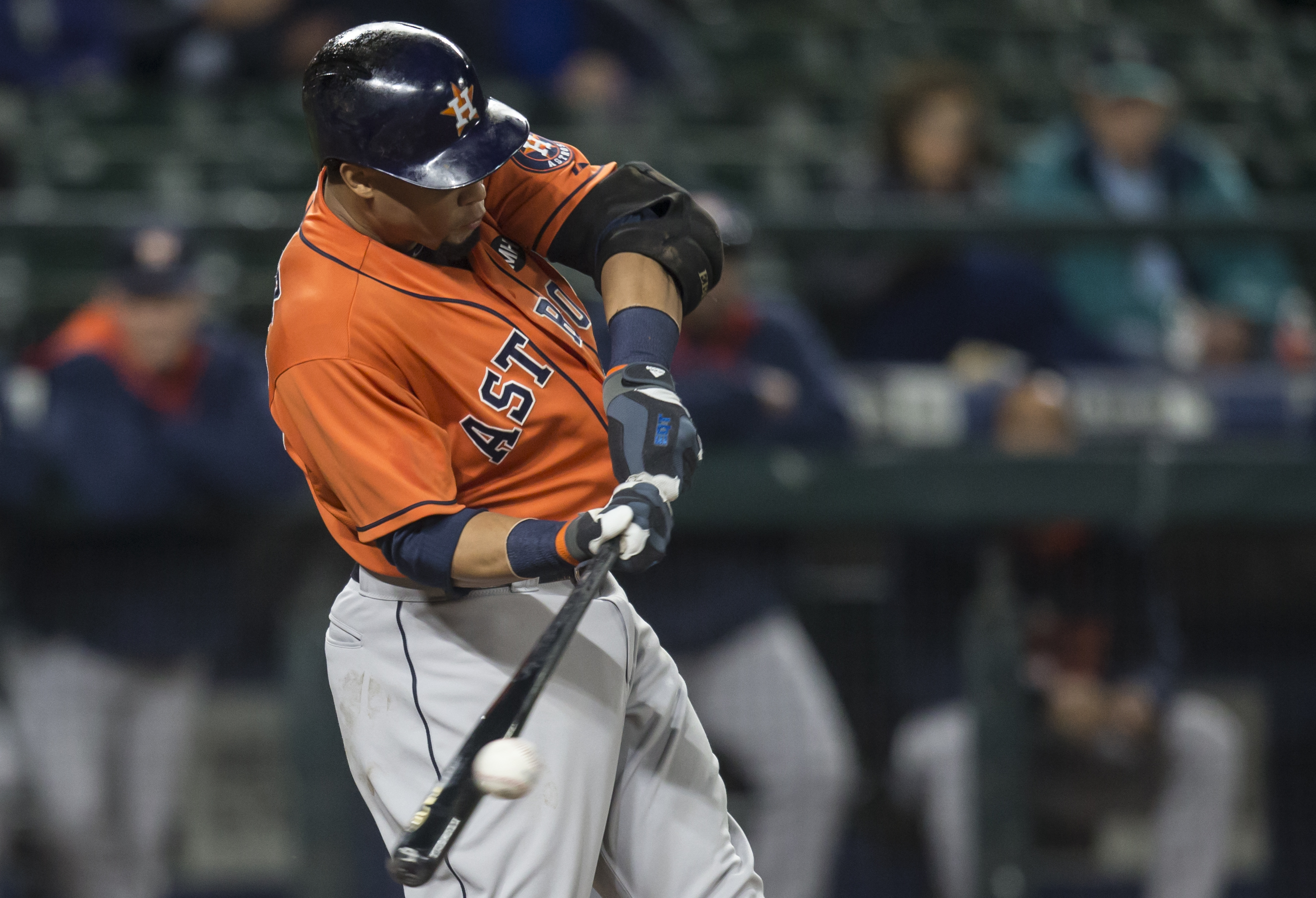 Houston Astros' Carlos Gomez hits a single during the second inning of a baseball game against the Seattle Mariners, Wednesday, Sept. 30, 2015, in Seattle. (AP Photo/Stephen Brashear)