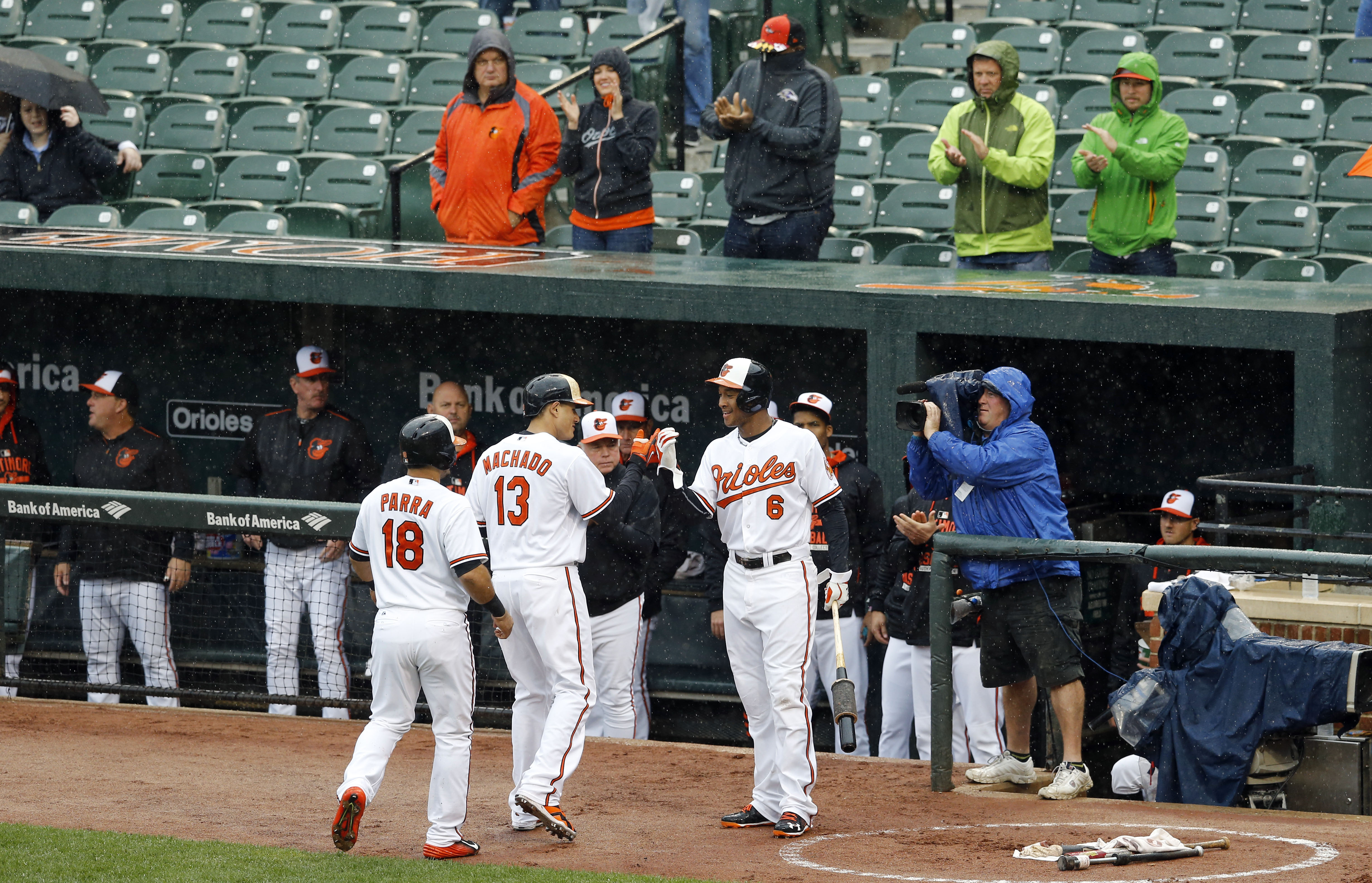 Baltimore Orioles' Manny Machado (13) high-fives teammate Jonathan Schoop (6) after he batted in Gerardo Parra on a home run in the first inning of a baseball game against the Toronto Blue Jays, Thursday, Oct. 1, 2015, in Baltimore. (AP Photo/Patrick Sema