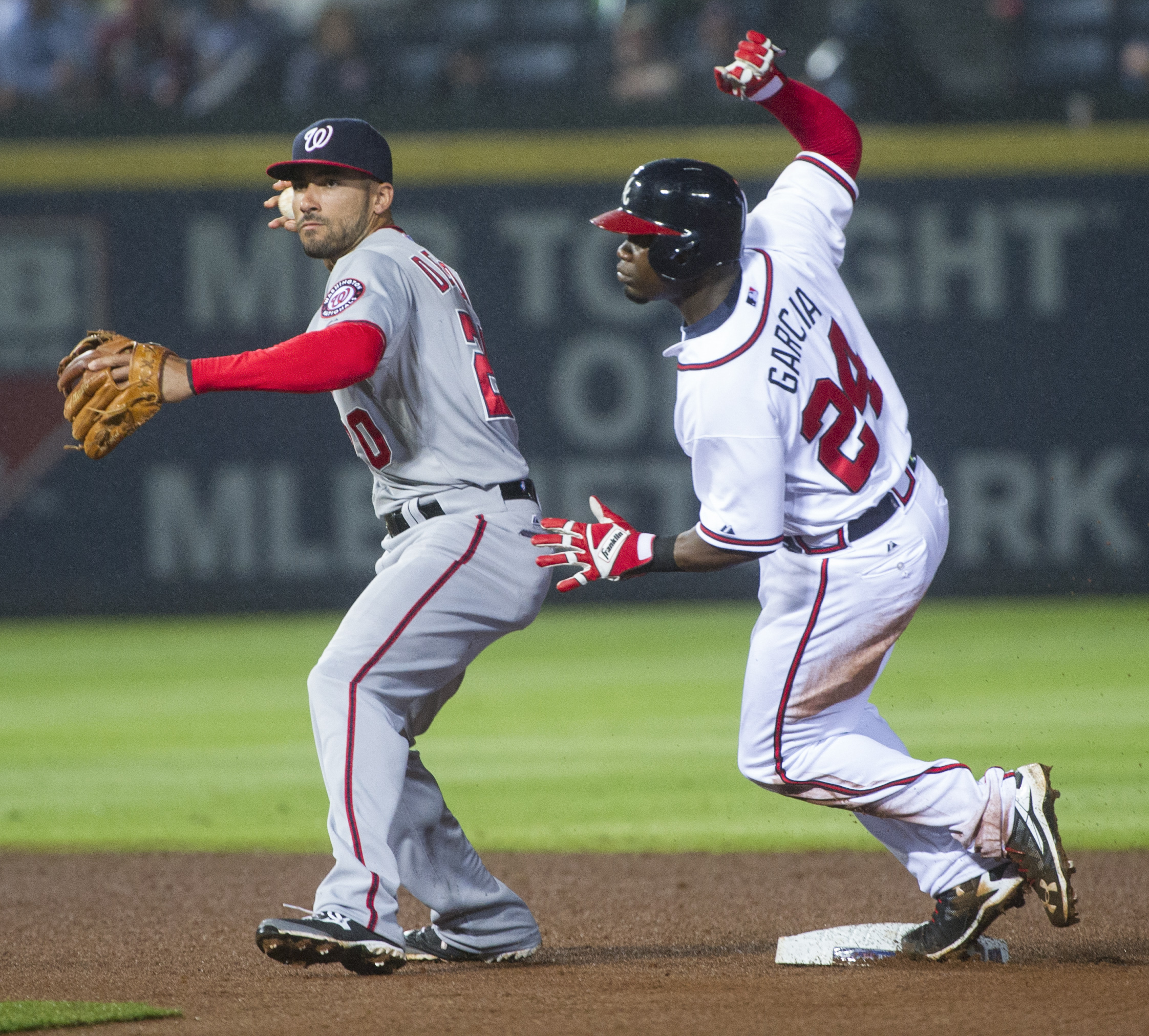 Atlanta Braves' Adonis Garcia (24) comes up after being forced out by Washington Nationals shortstop Ian Desmond on a single by Nick Swisher during the fourth inning of a baseball game, Thursday, Oct. 1, 2015, in Atlanta. (AP Photo/John Amis)