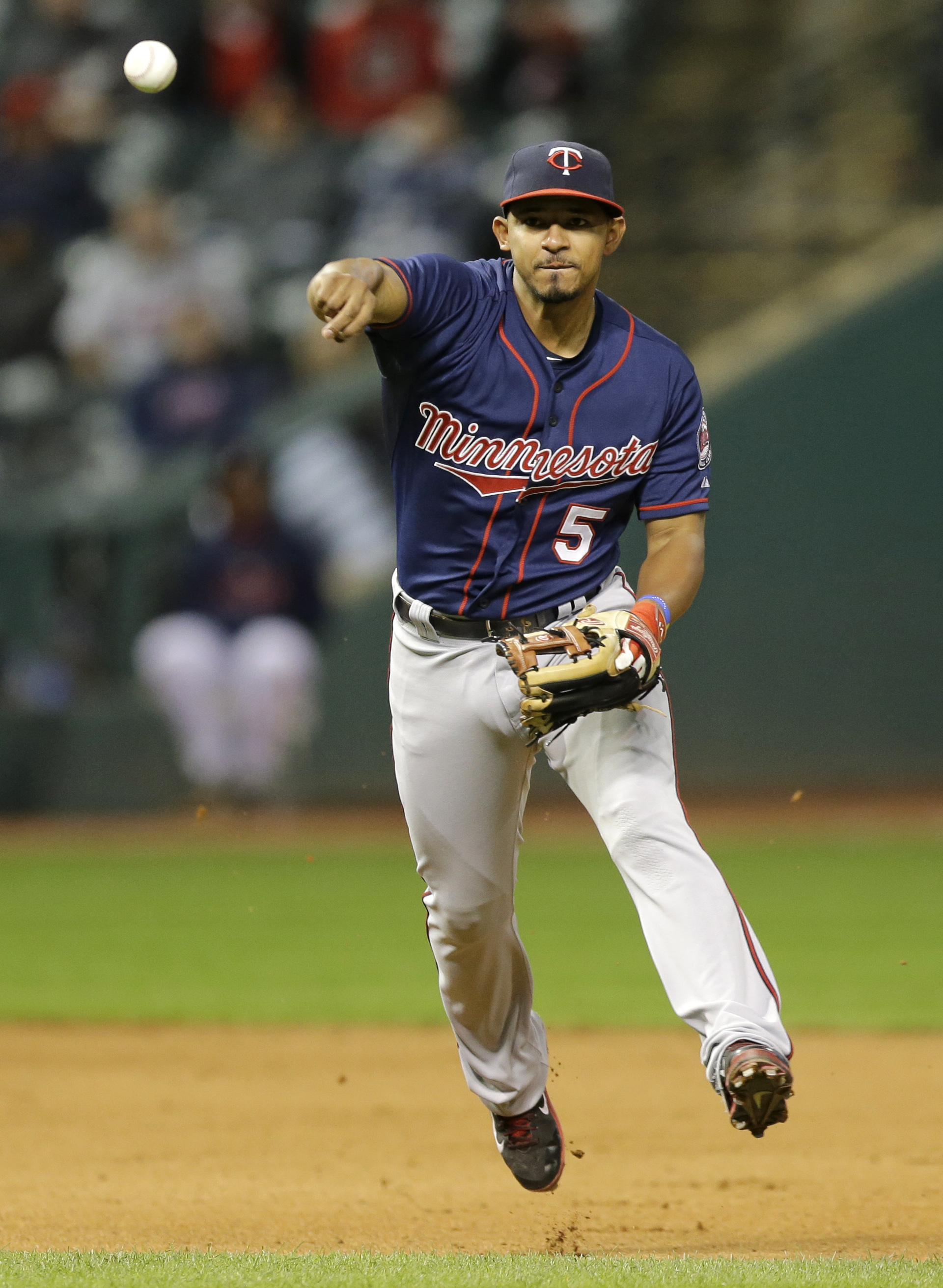 Minnesota Twins' Eduardo Escobar throws to first base to get Cleveland Indians' Michael Martinez in the seventh inning of a baseball game, Thursday, Oct. 1, 2015, in Cleveland. Martinez was out on the play. (AP Photo/Tony Dejak)