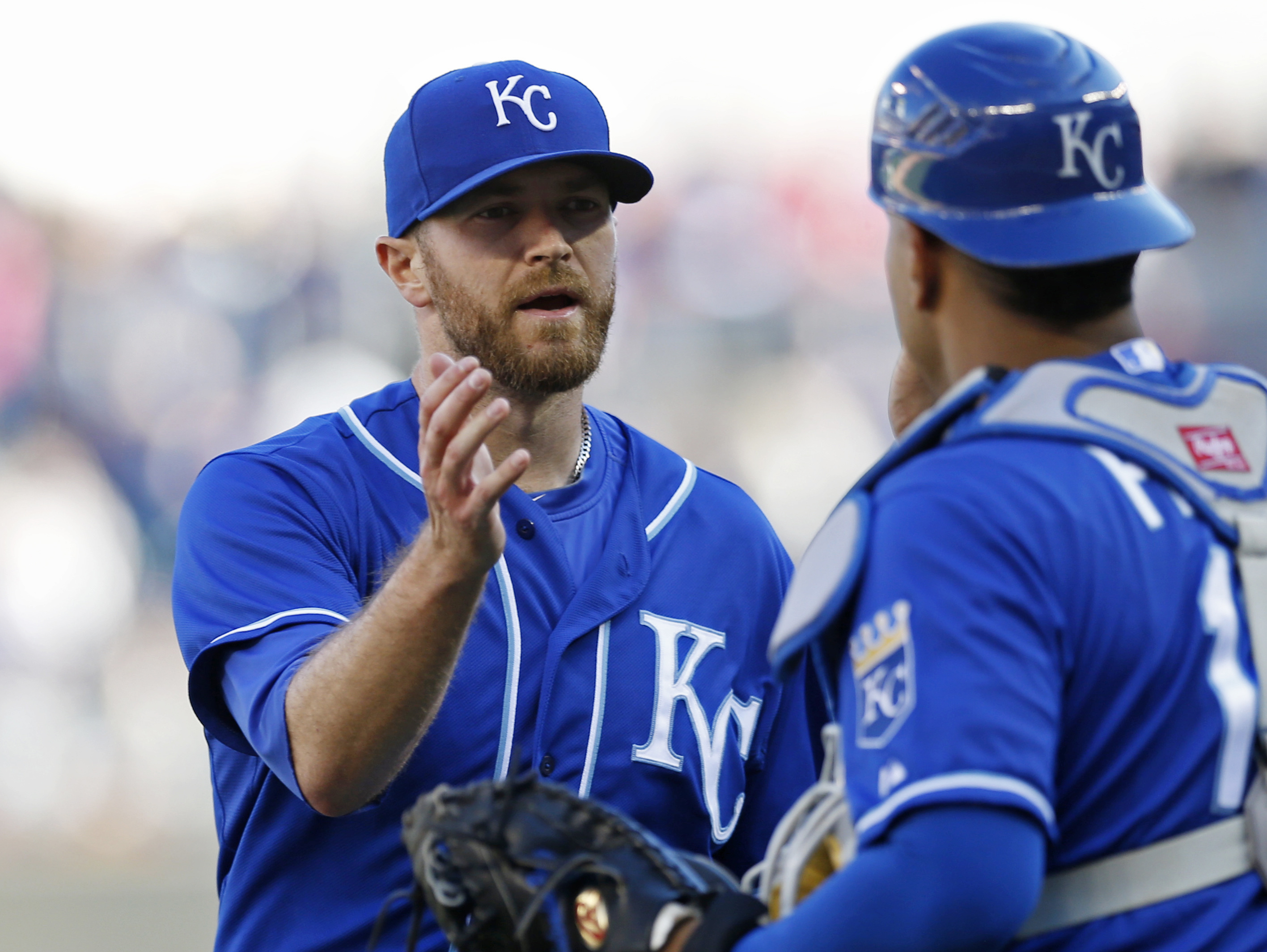 Kansas City Royals pitcher Wade Davis, left, and catcher Salvador Perez celebrate the Royals' 5-1 win over the Minnesota Twins in a baseball game, Saturday, Oct. 3, 2015, in Minneapolis. The Royals win ended the Twins playoff chances. Davis entered the ni