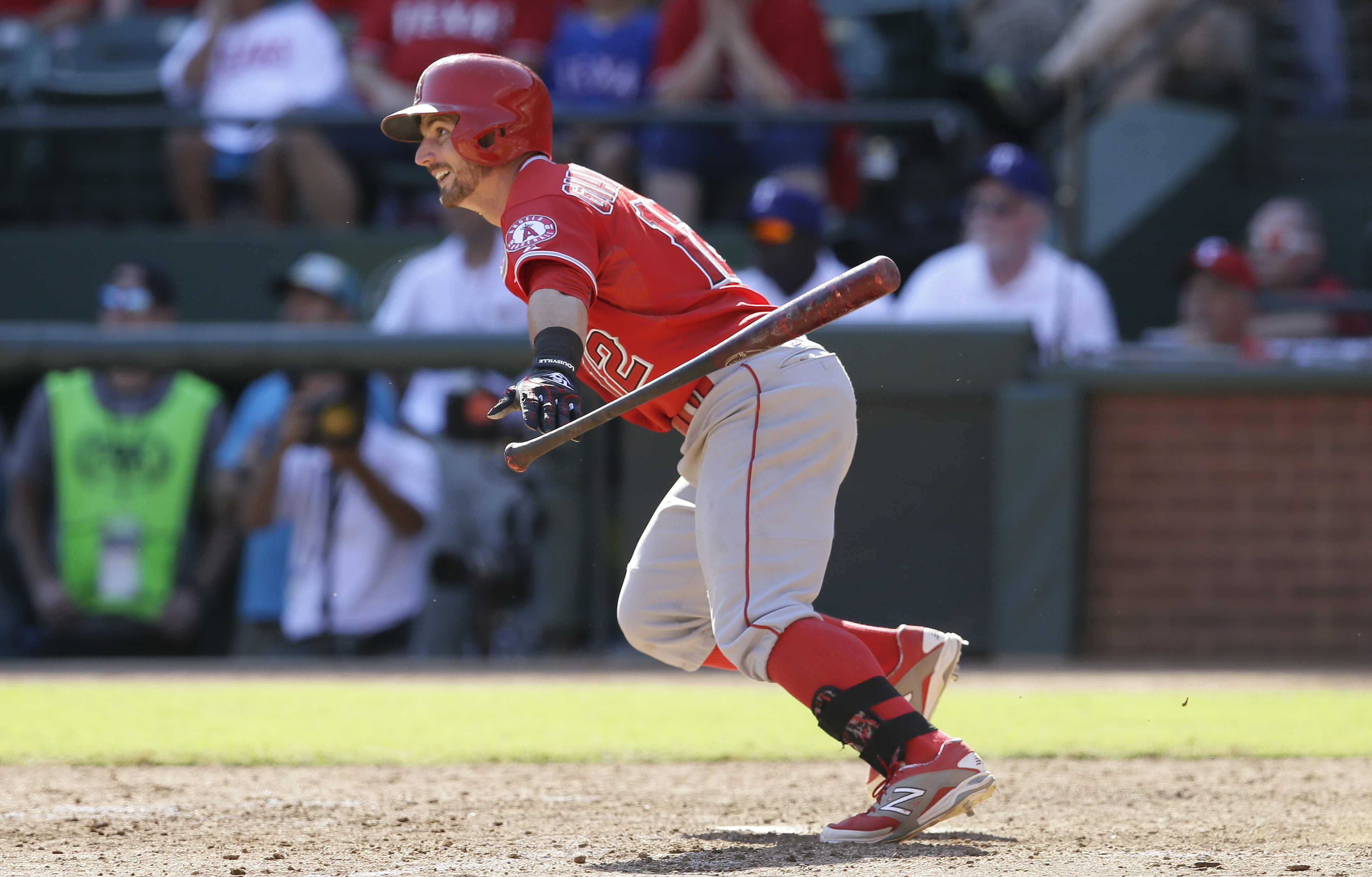 Los Angeles Angels' Johnny Giavotella watches his RBI single that scored teammate Drew Stubbs in the ninth inning of a baseball game against the Texas Rangers in Arlington, Texas, Saturday, Oct. 3, 2015. The Angels won 11-10. (AP Photo/LM Otero)