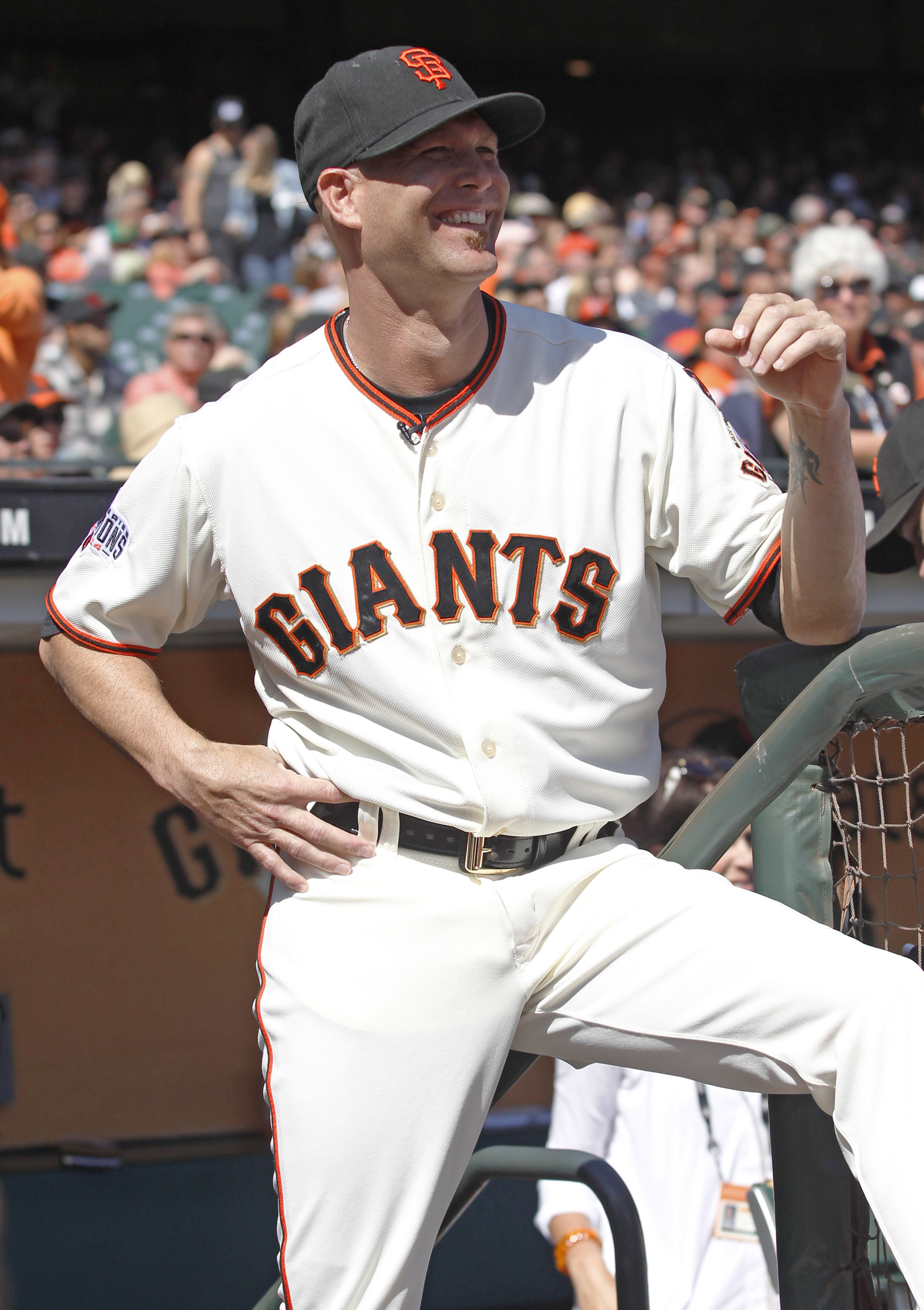 San Francisco Giants pitcher Tim Hudson smiles at the start of a ceremony, commemorating his career before a baseball game between the San Francisco Giants and the Colorado Rockies, Saturday, Oct. 3, 2015, in San Francisco.  (AP Photo/George Nikitin)