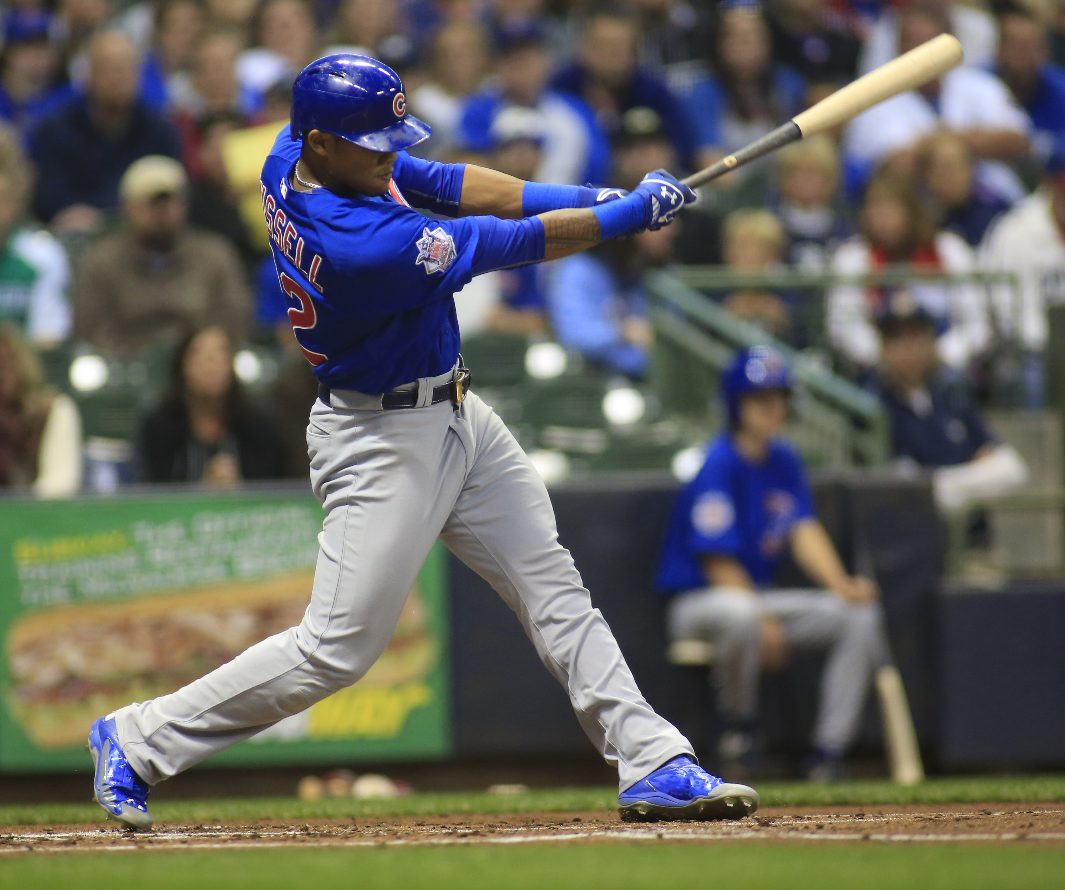 Chicago Cubs' Addison Russell hits a RBI single against the Milwaukee Brewers during the second inning of a baseball game Saturday, Oct. 3, 2015, in Milwaukee. (AP Photo/Darren Hauck)