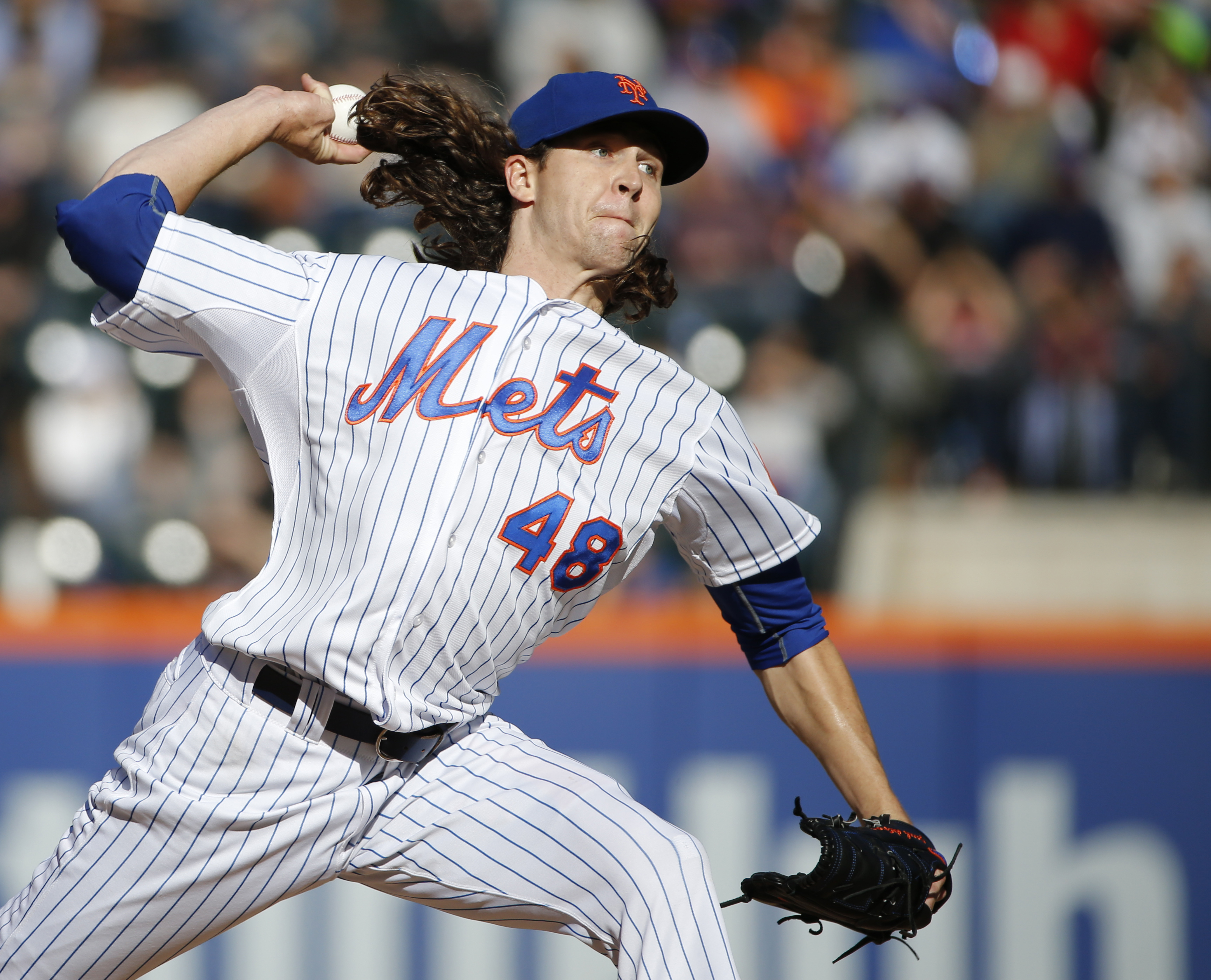 New York Mets starting pitcher Jacob deGrom delivers in the second inning of a baseball game against the Washington Nationals in New York, Sunday, Oct. 4, 2015. (AP Photo/Kathy Willens)
