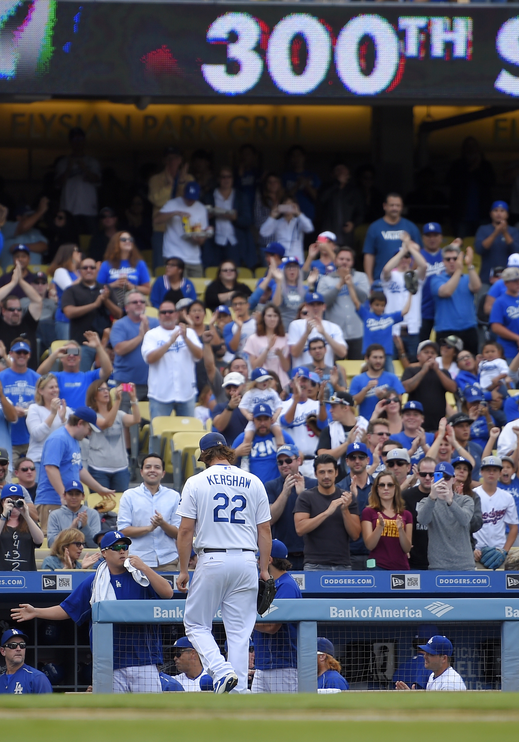 Los Angeles Dodgers starting pitcher Clayton Kershaw walks off the field after pitching his 300th seasonal strikeout in the third inning of a baseball game against the San Diego Padres, Sunday, Oct. 4, 2015, in Los Angeles. (AP Photo/Mark J. Terrill)
