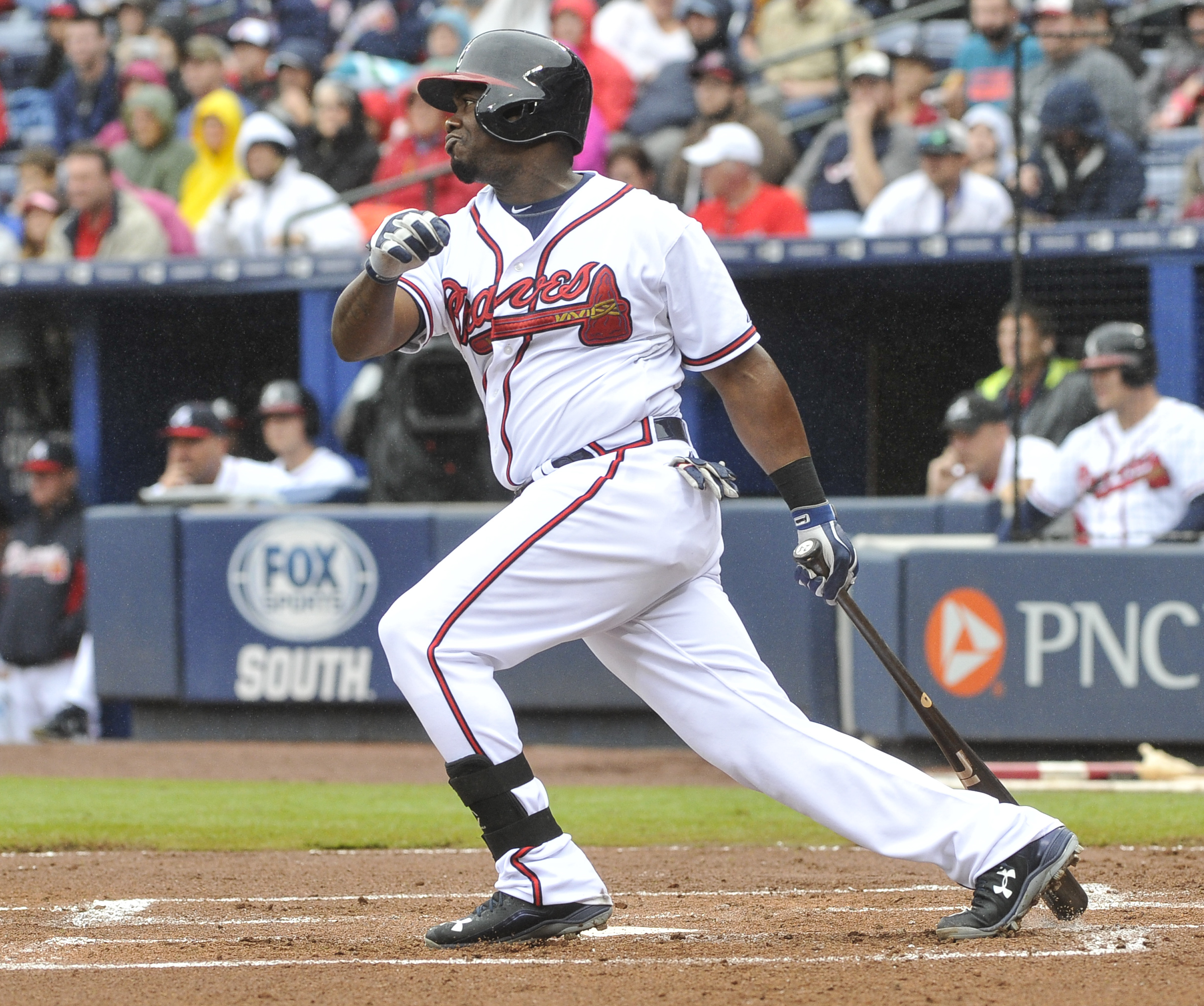 Atlanta Braves' Adonis Garcia (24) during singles on a line drive to center field hitting in Michael Bourn during the first inning of the second baseball game of a doubleheader, Sunday, Oct. 4, 2015, in Atlanta. (AP Photo/John Amis)