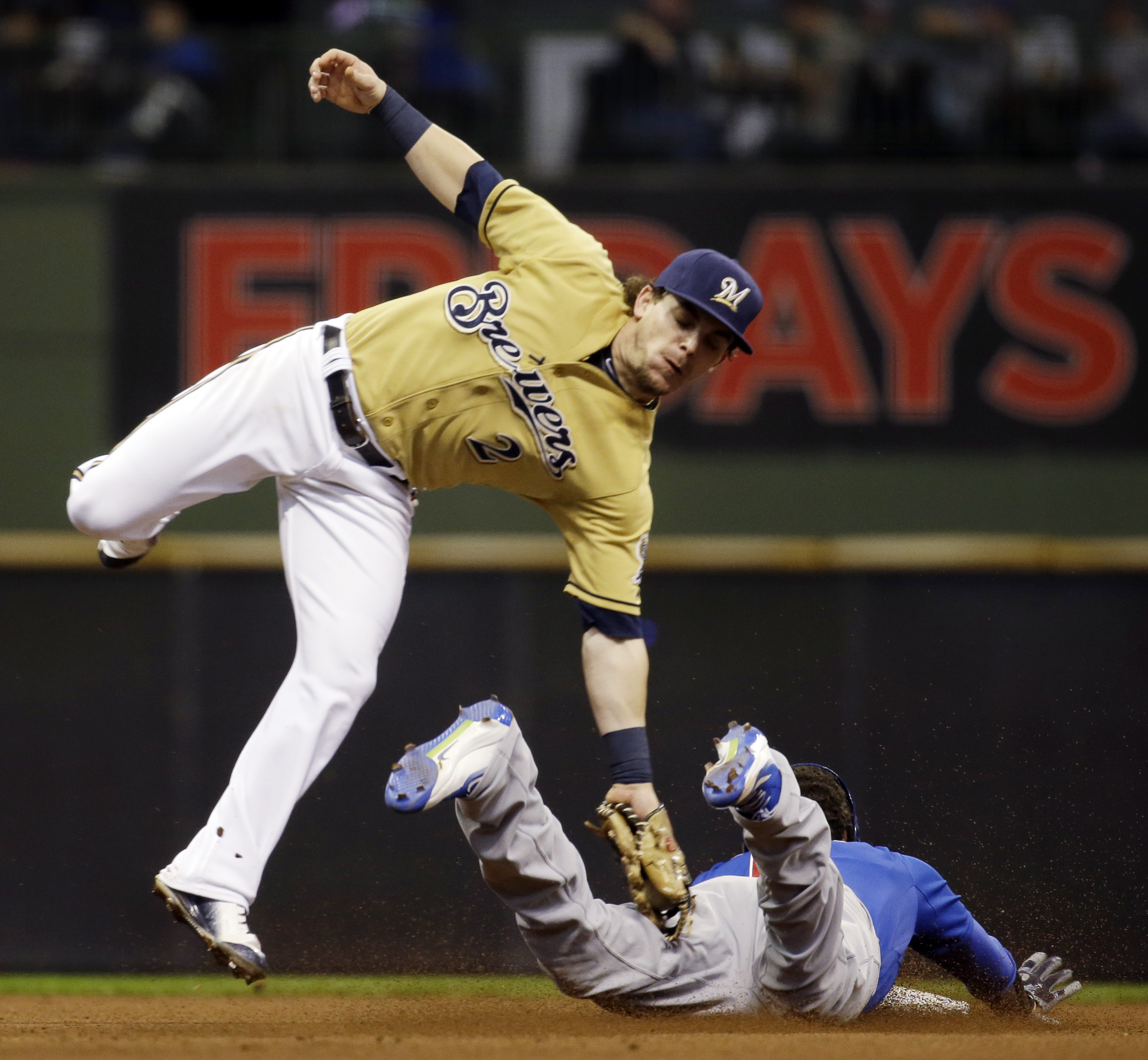 Chicago Cubs' Quintin Berry slides safely under the tag of Milwaukee Brewers' Scooter Gennett as he steals second during the eighth inning of a baseball game, Sunday, Oct. 4, 2015, in Milwaukee. (AP Photo/Morry Gash)