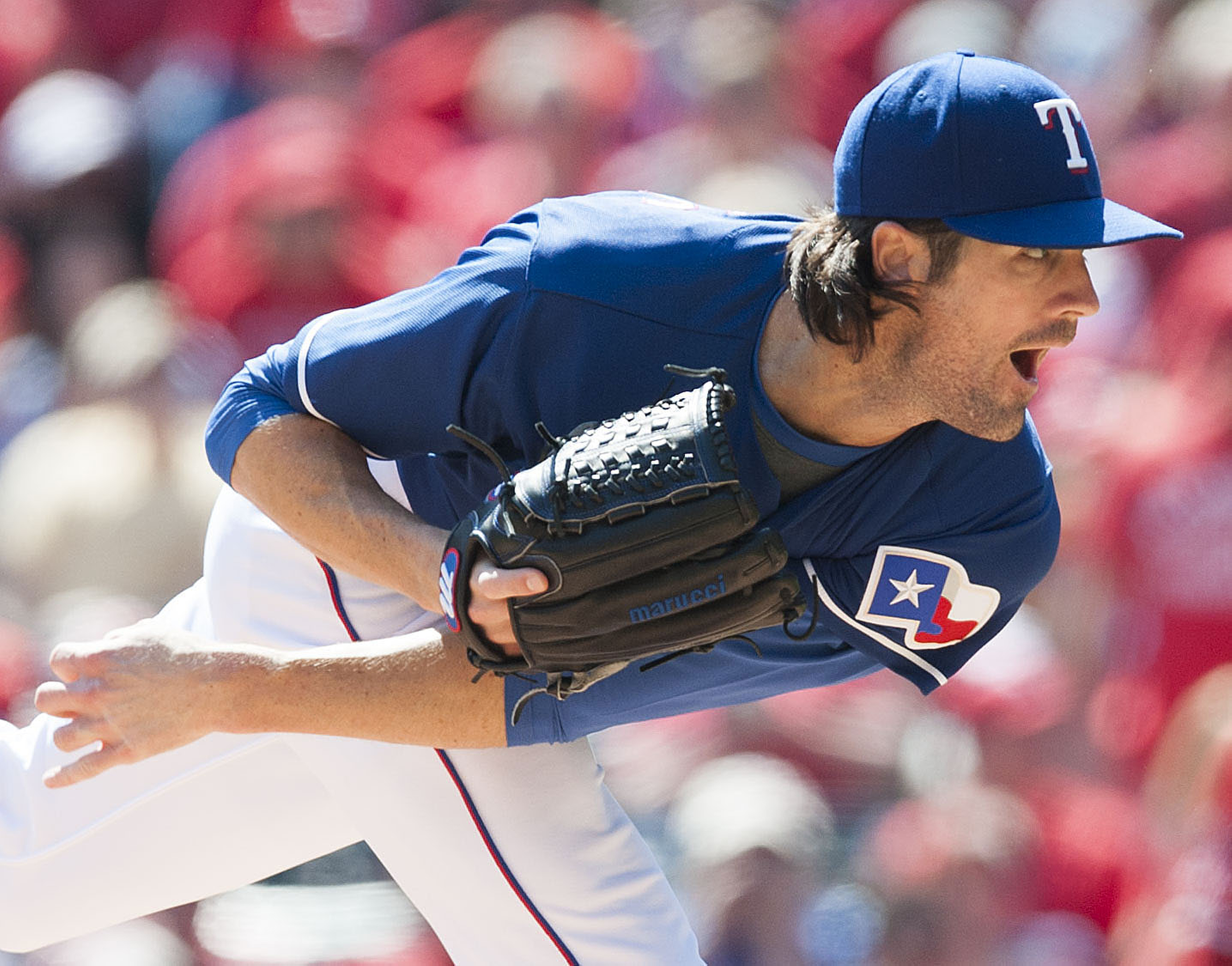 Texas Rangers starting pitcher Cole Hamels delivers during a baseball game against the Los Angeles Angels in Arlington, Texas, Sunday, Oct. 4, 2015. The Rangers clinched the AL West title on the last day of the regular season with the 9-2 win.  (Kevin Sul