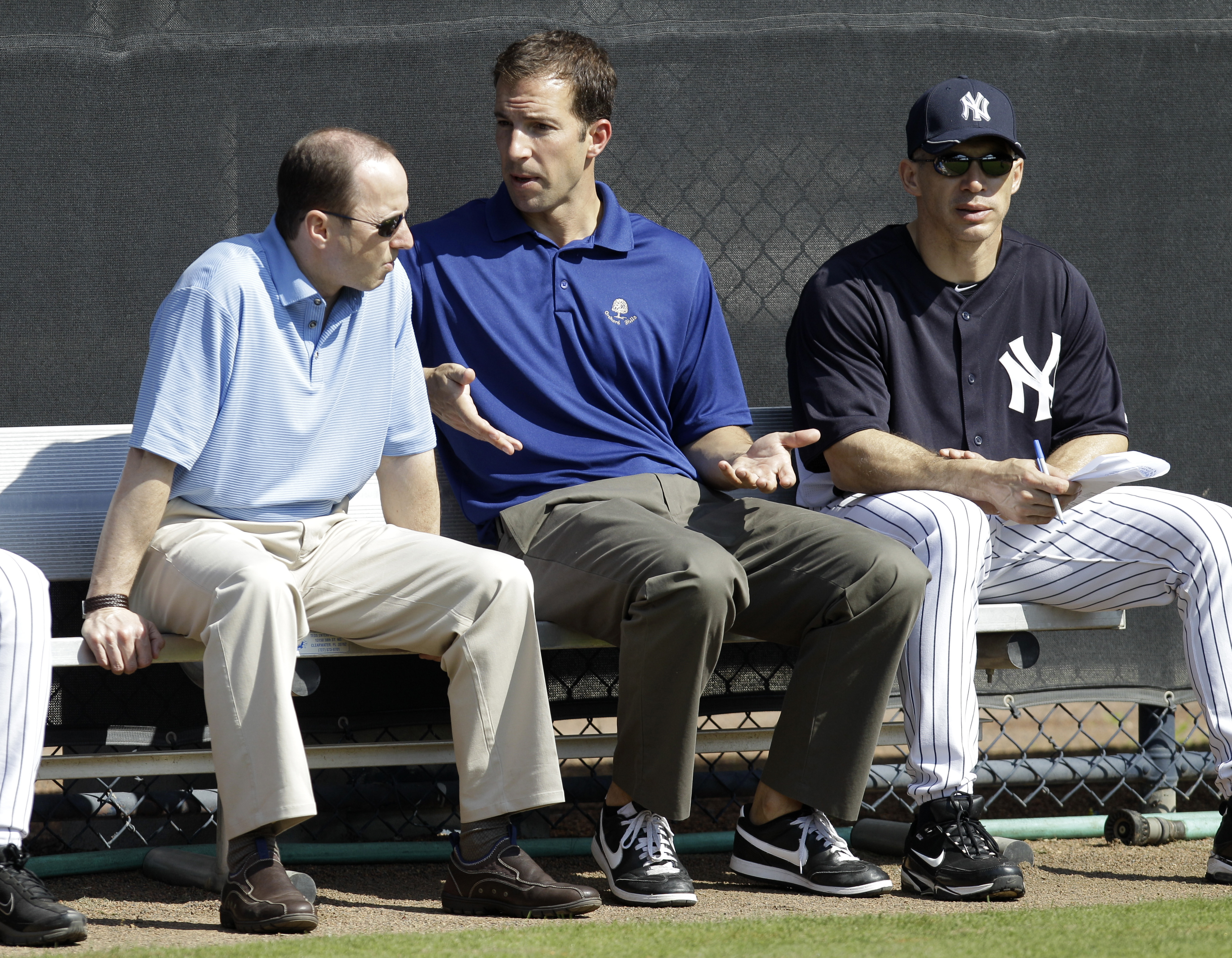 New York Yankees General Manager Brian Cashman, left, Director of Professional Scouting Billy Eppler, center, and manager Joe Girardi sit in the bullpen during a baseball spring training workout Wednesday, Feb. 16, 2011, at Steinbrenner Field in Tampa, Fl