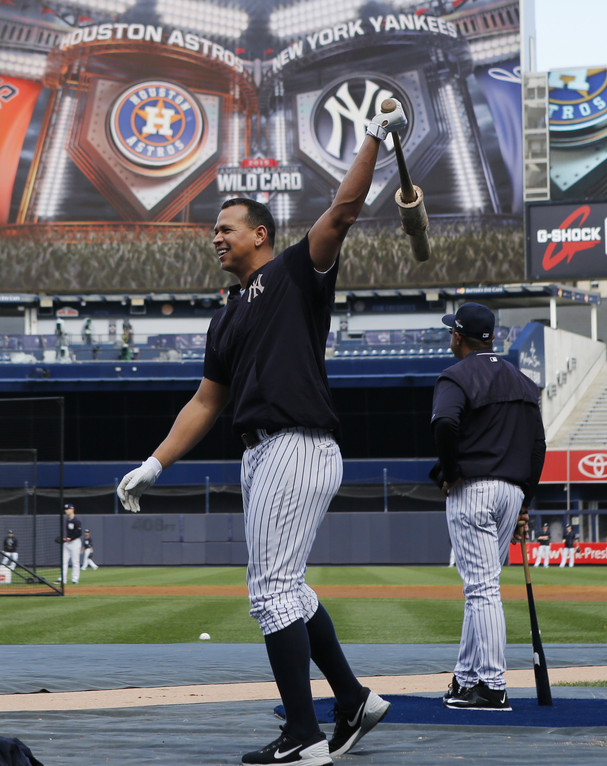 New York Yankees designated hitter Alex Rodriguez swings a weighted bat during a workout at Yankee Stadium in New York, Monday, Oct. 5, 2015, for an American League Wild Card baseball game against the Houston Astros on Tuesday. (AP Photo/Kathy Willens)