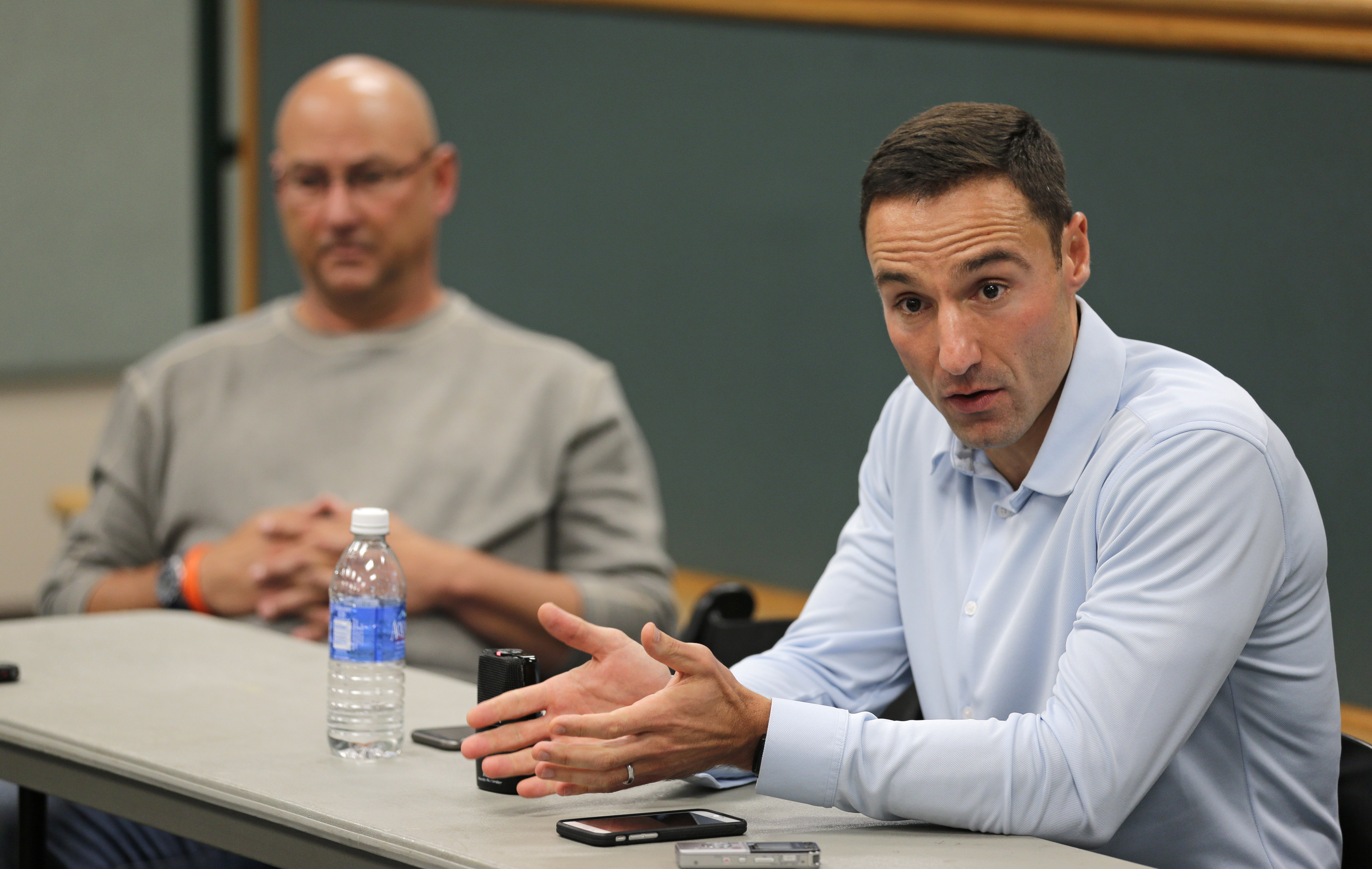 Chris Antonetti, right, president of baseball operations for the Cleveland Indians, answers questions at a news conference Tuesday, Oct. 6, 2015, in Cleveland. With president Mark Shapiro leaving Cleveland after 24 seasons to take the same position with t