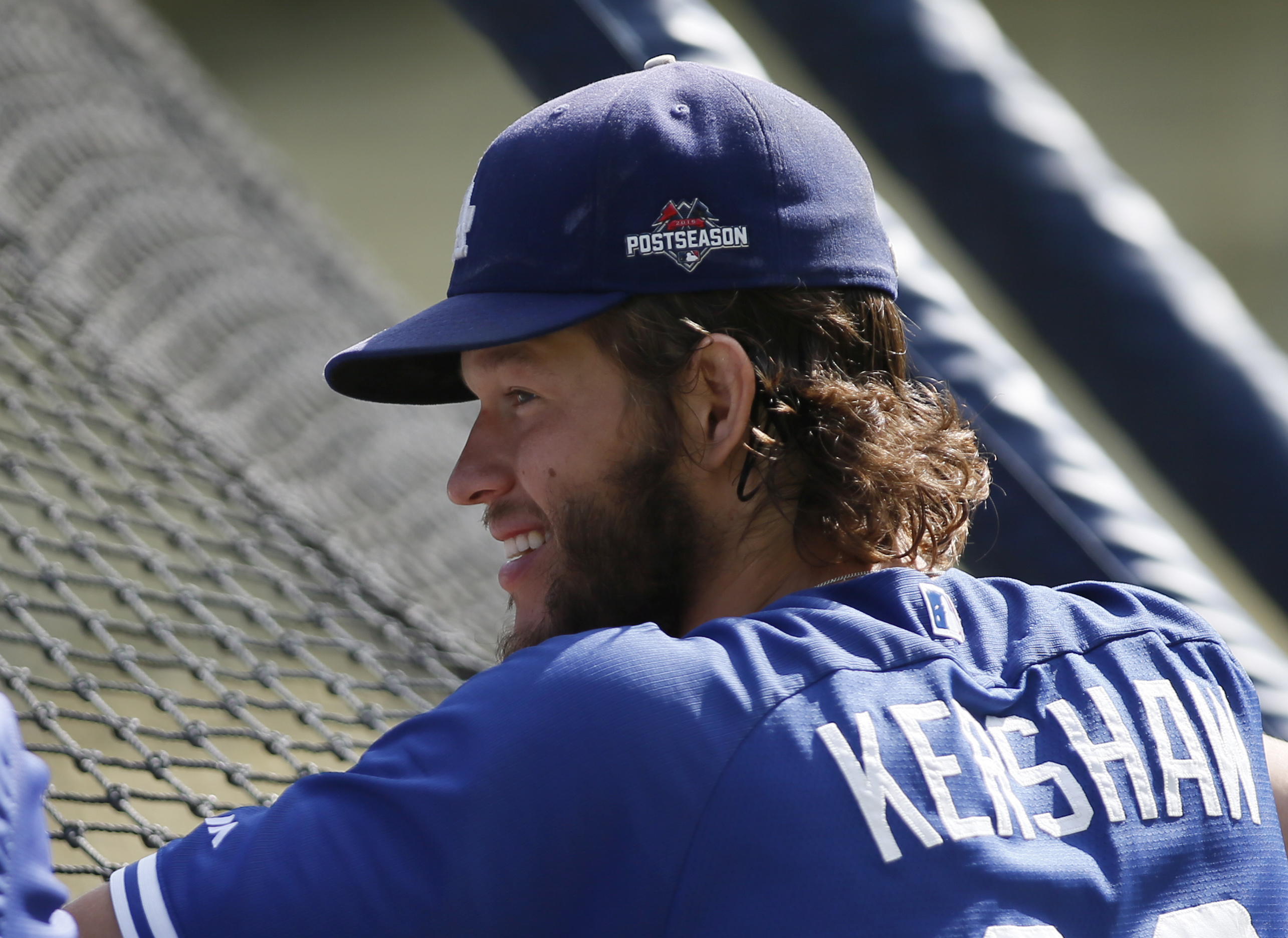 Los Angeles Dodgers pitcher Clayton Kershaw looks on during practice for the upcoming NLDS playoff baseball series against the New York Mets, Tuesday, Oct. 6, 2015, in Los Angeles. Their NLDS best of five playoff series begins Friday, Oct. 9, at Dodger St