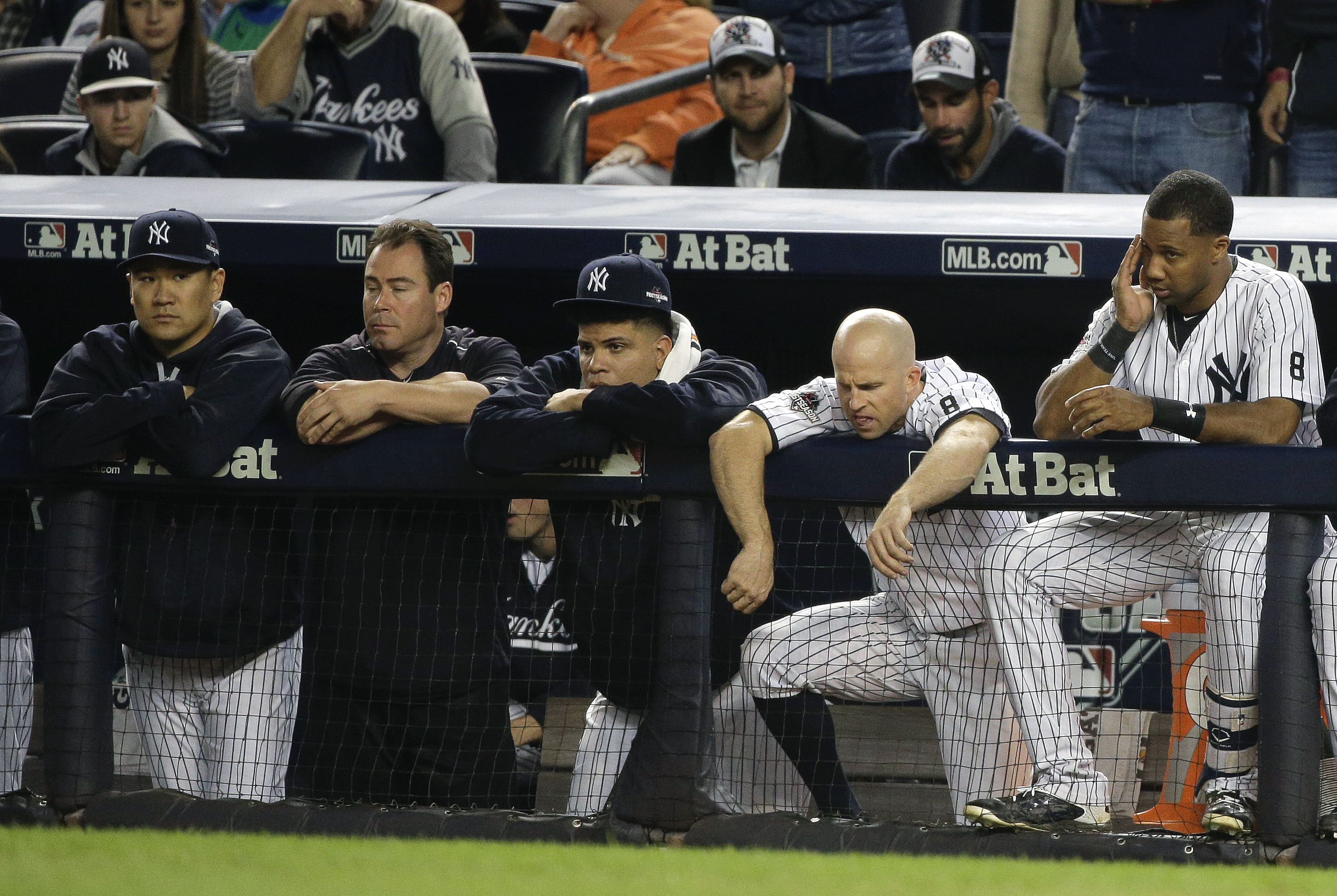 New York Yankees pitcher Masahiro Tanaka, far left, Dellin Betances, second from left, Brett Gardner, second from right, and Chris Young, right, watch from the dugout against the Houston Astros during the ninth inning of the American League wild card base