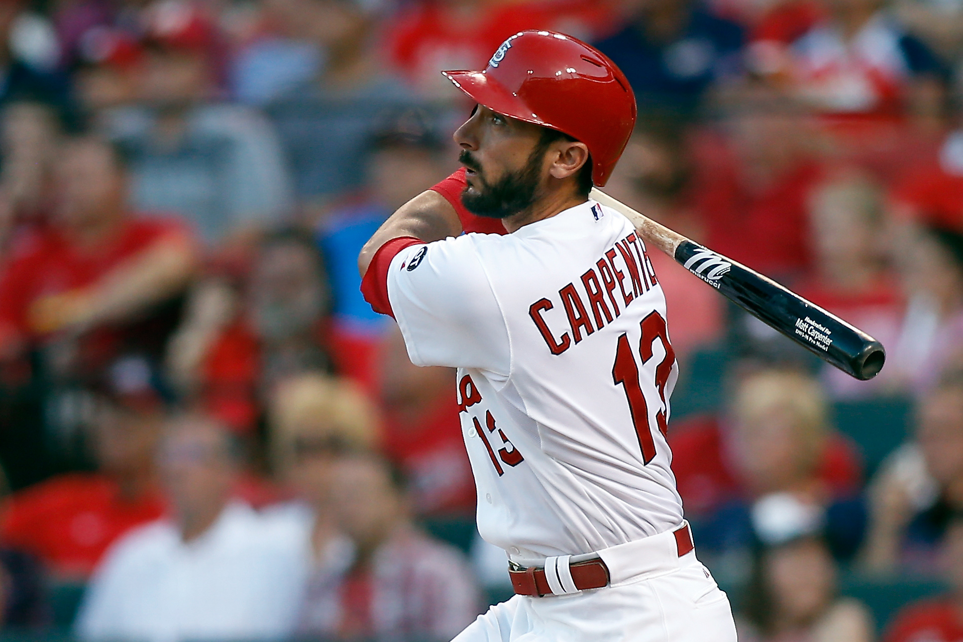 FILE - In this July 31, 2015, file photo, St. Louis Cardinals' Matt Carpenter watches his solo home run during the first inning of a baseball game against the Colorado Rockies in St. Louis. Carpenter really muscled up this season. The St. Louis Cardinals
