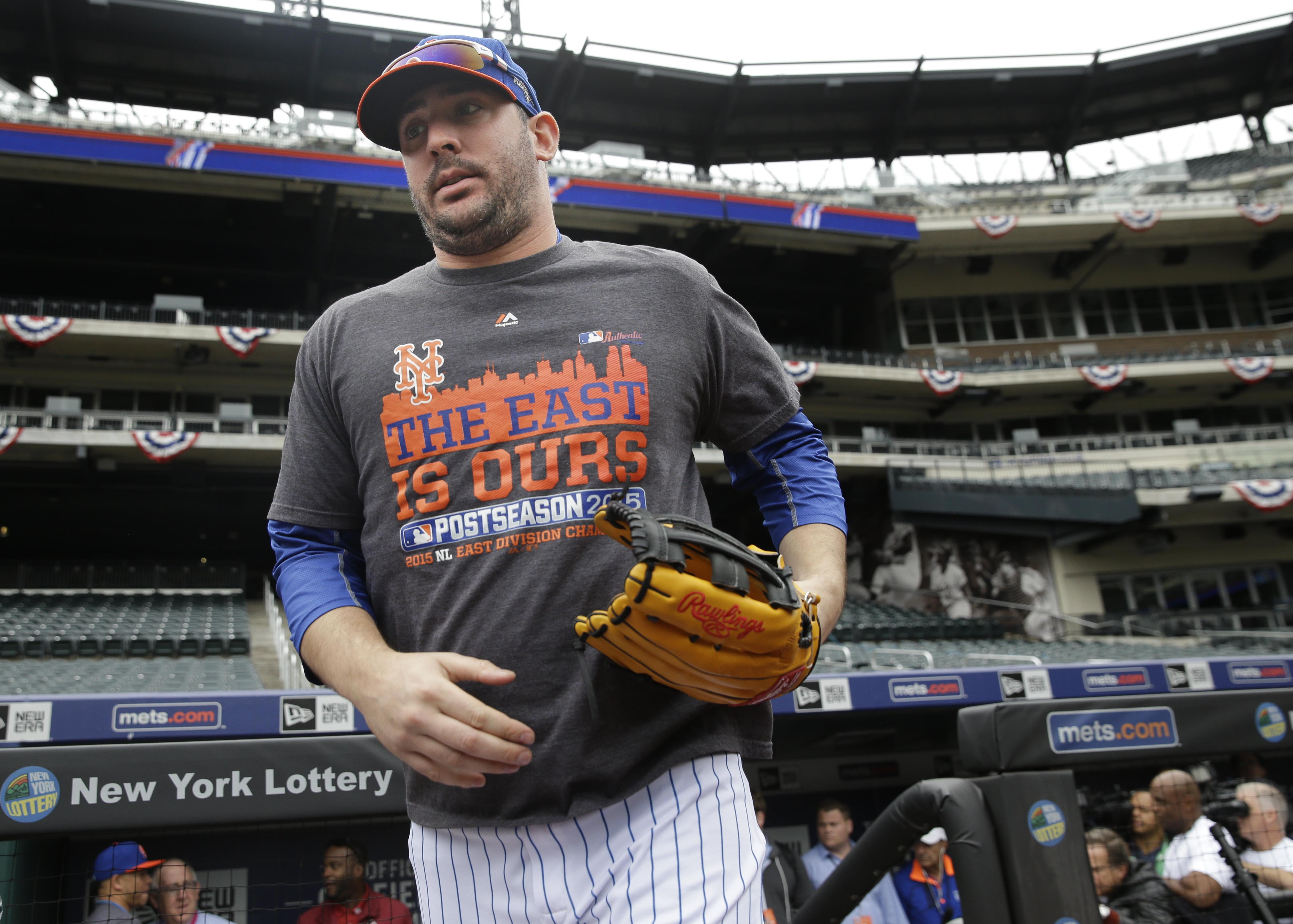 New York Mets' pitcher Matt Harvey runs out onto the field before a workout at Citi Field, Wednesday, Oct. 7, 2015 in New York. The Mets will play the Los Angeles Dodgers in a National League Division Series starting Friday in Los Angeles. (AP Photo/Seth
