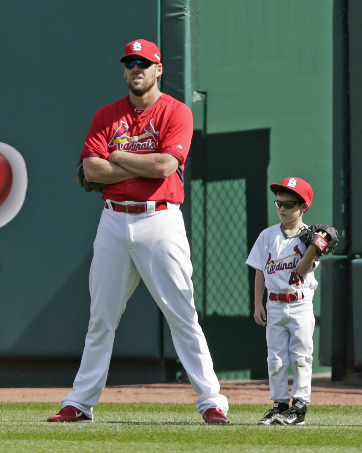 St. Louis Cardinals Game 1 starter John Lackey stands in the outfield with his six-year-old son, Carter, during the team workout, Thursday, Oct. 8, 2015 in St. Louis. The Cardinals will face the Chicago Cubs for the first time in post-season history, in a
