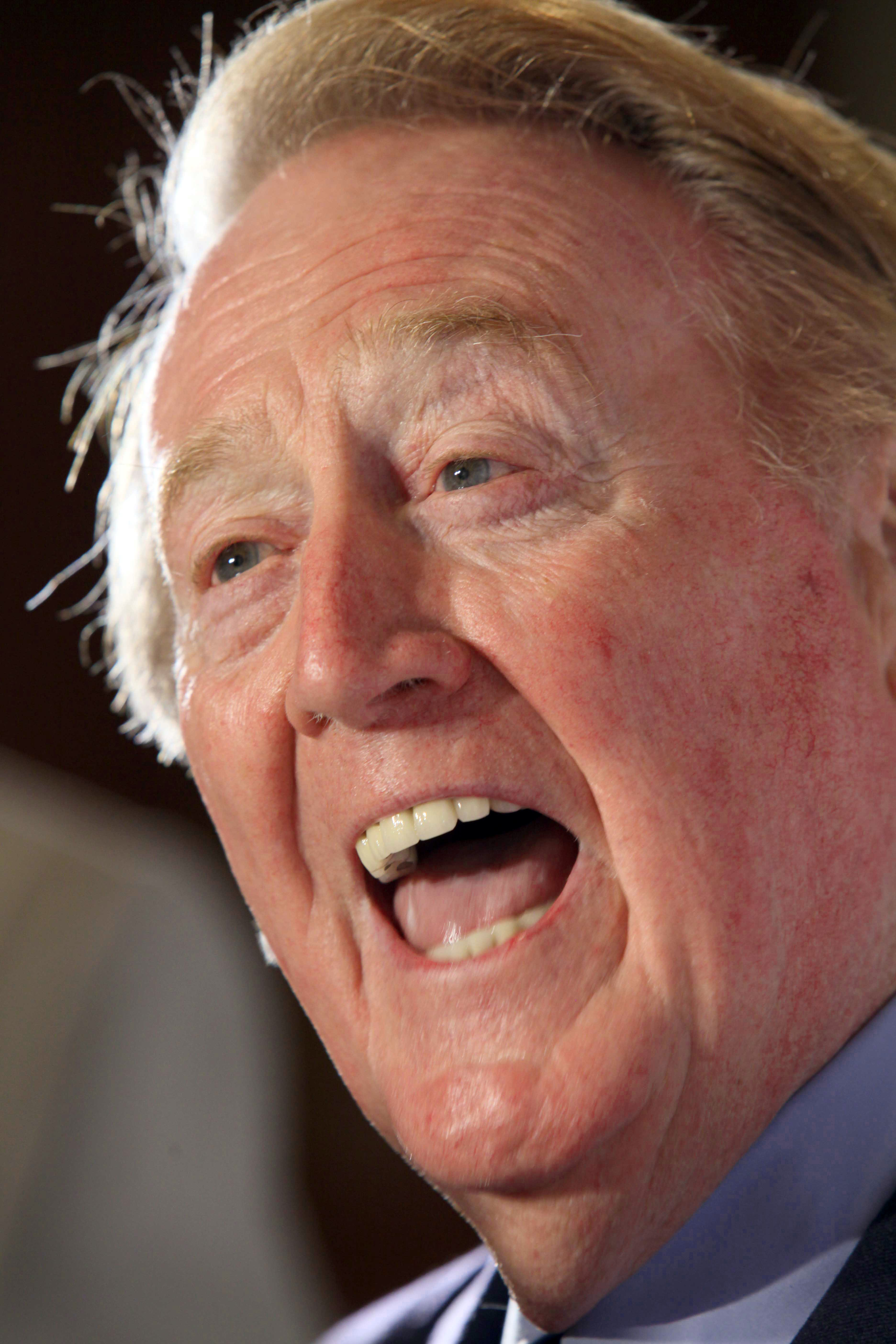 FILE - In this Nov. 10, 2009, file photo, Vin Scully, the play-by-play announcer for the Los Angeles Dodgers, speaks to members of the media during the Hollywood Radio and Television Society's Newsmaker Luncheon in Beverly Hills, Calif. Scully will not be