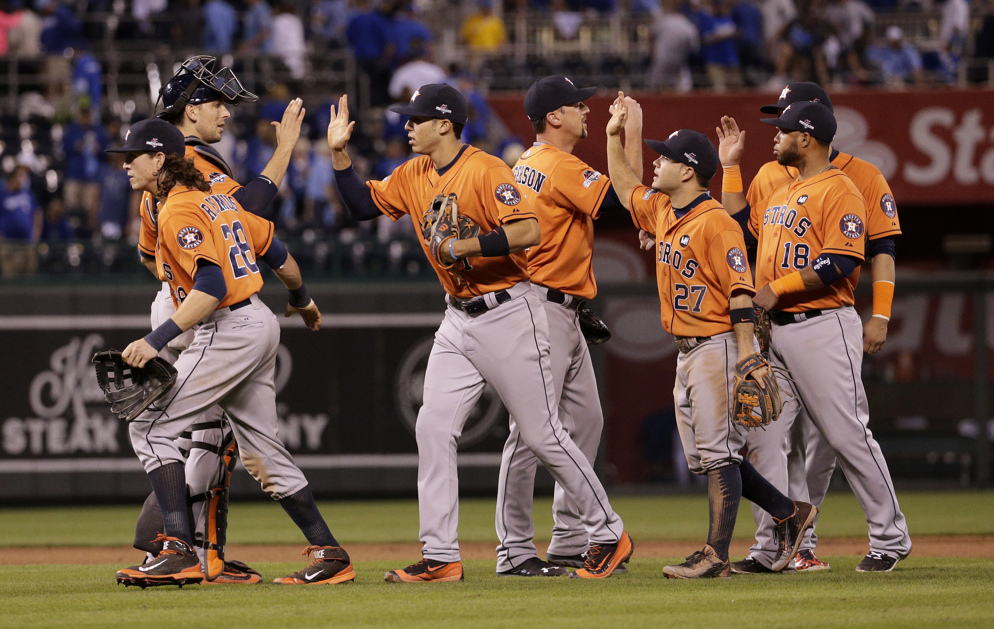 Houston Astros players celebrate after their victory over the Kansas City Royals in Game 1 of baseball's American League Division Series, Thursday, Oct. 8, 2015, in Kansas City, Mo. (AP Photo/Charlie Riedel)