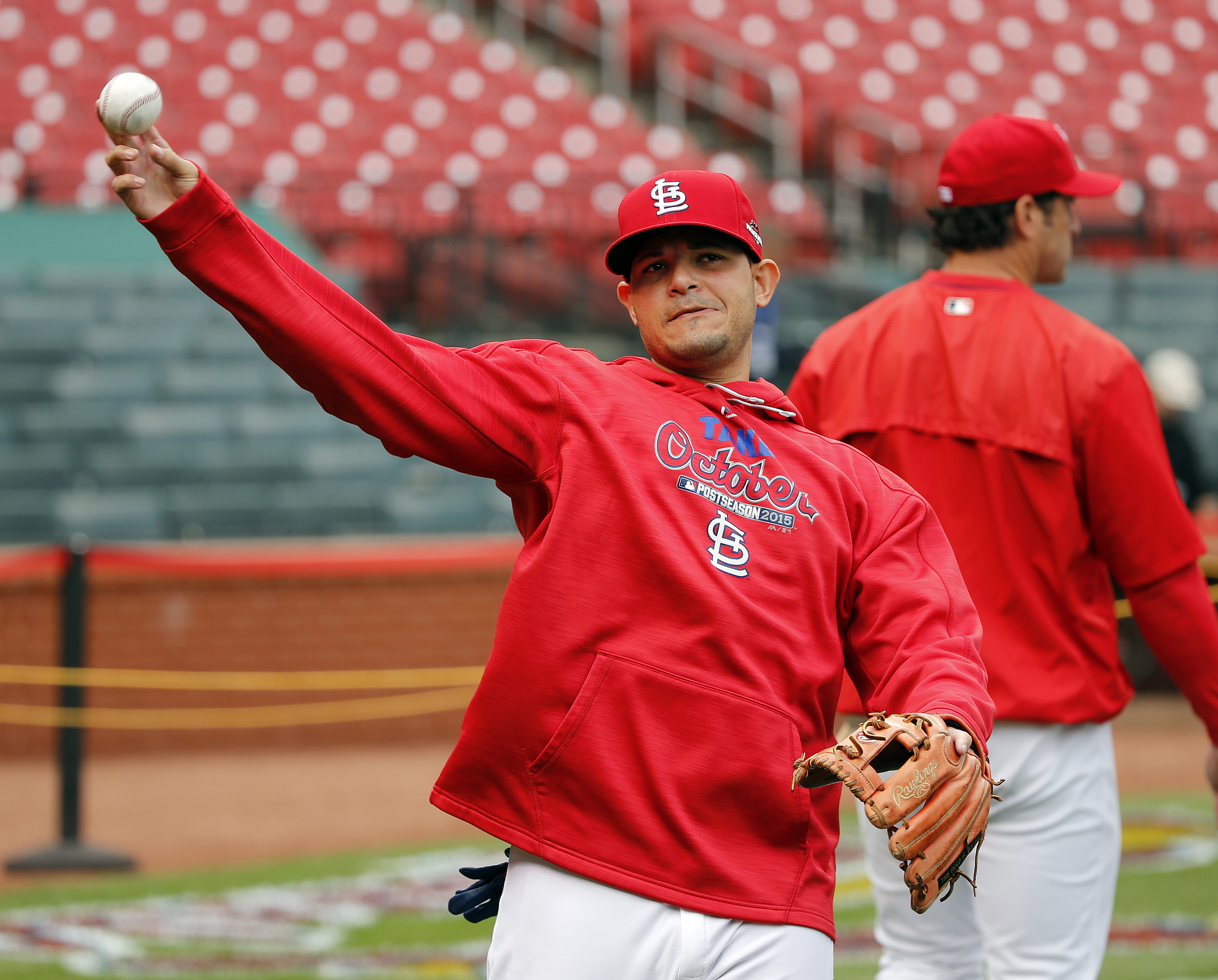St. Louis Cardinals' Yadier Molina throws before Game 1 in baseball's National League Division Series against the Chicago Cubs, Friday, Oct. 9, 2015, in St. Louis. (AP Photo/Charles Rex Arbogast)