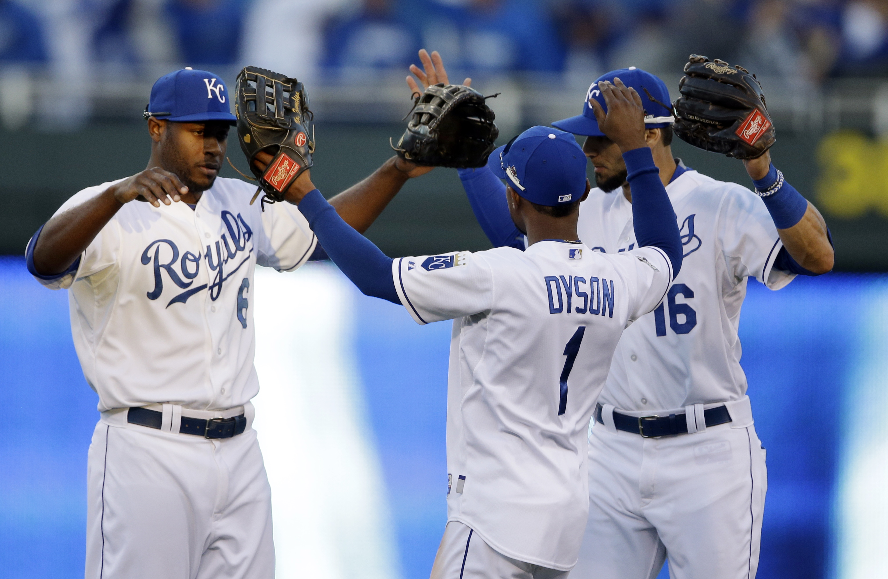 Kansas City Royals players, from left, Lorenzo Cain, Jarrod Dyson and Paulo Orlando celebrate after their 5-4 victory over the Houston Astros in Game 2 of baseball's American League Division Series, Friday, Oct. 9, 2015, in Kansas City, Mo. (AP Photo/Orli
