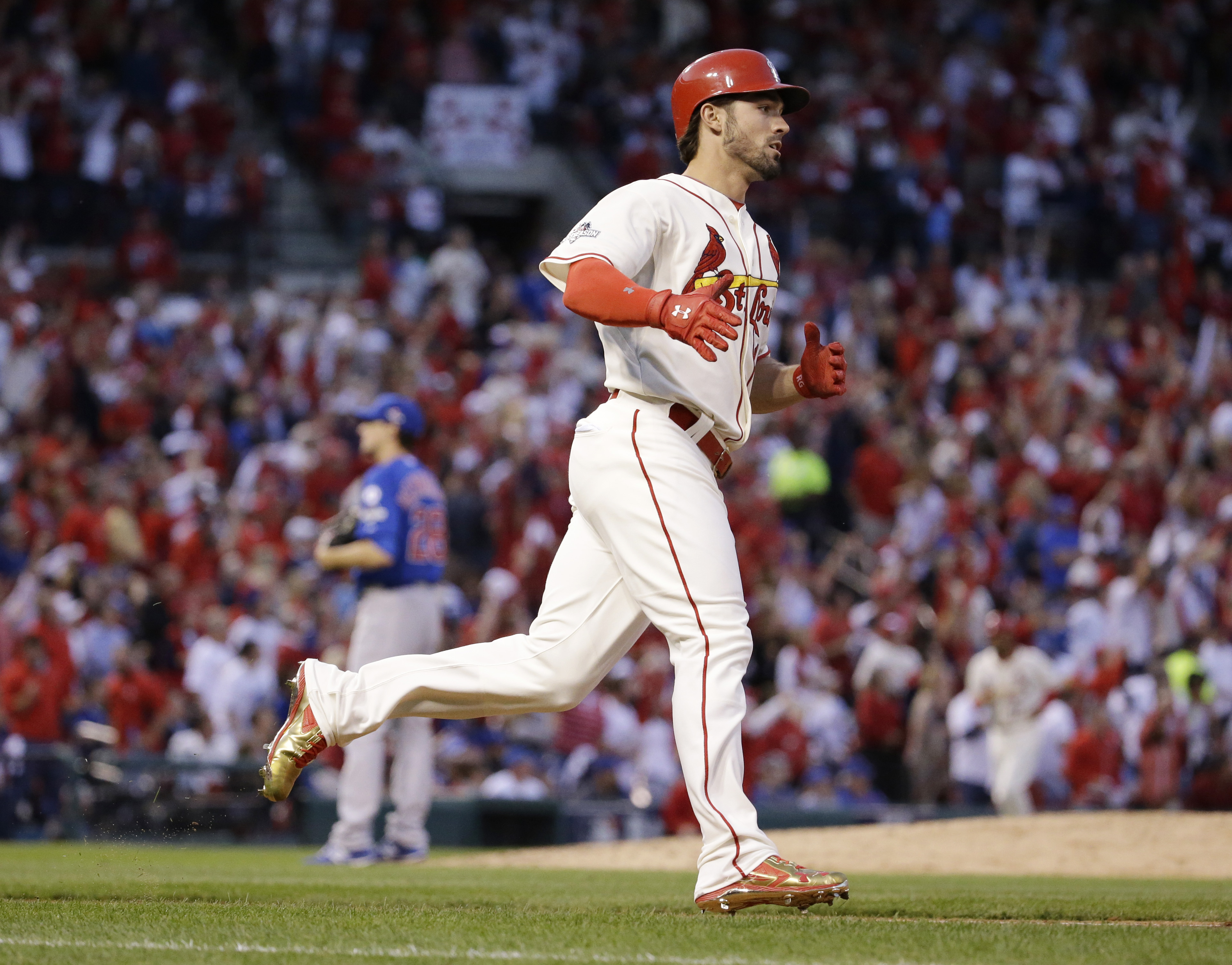 St. Louis Cardinals' Randal Grichuk runs after hitting a solo home run off Chicago Cubs starting pitcher Kyle Hendricks (28)  during the fifth inning of Game 2 in baseball's National League Division Series Saturday, Oct. 10, 2015, in St. Louis. (AP Photo/