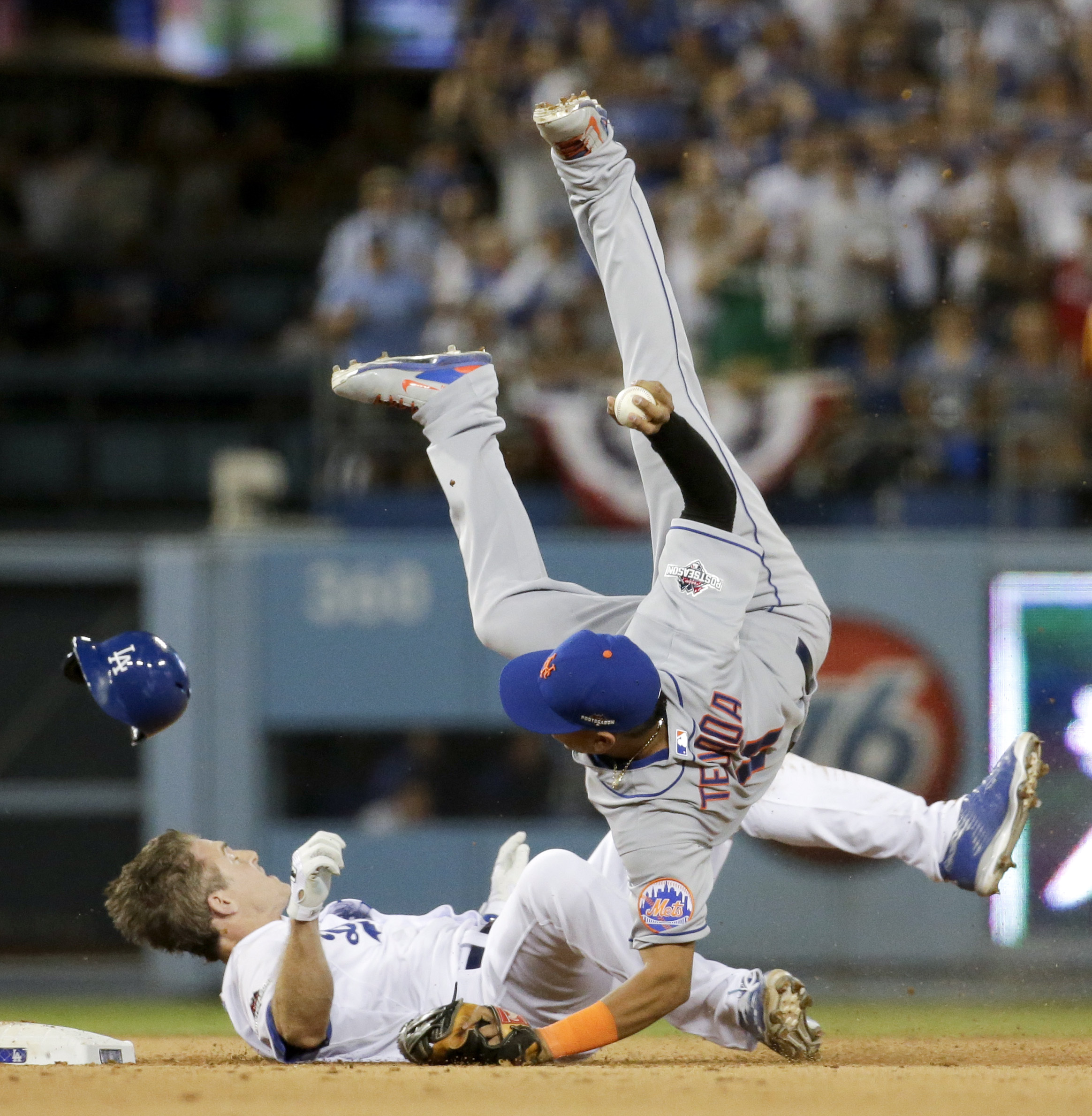 New York Mets shortstop Ruben Tejada, goes over the top of Los Angeles Dodgers' Chase Utley who broke up a double play during the seventh inning in Game 2 of baseball's National League Division Series, Saturday, Oct. 10, 2015 in Los Angeles. (AP Photo/Gre