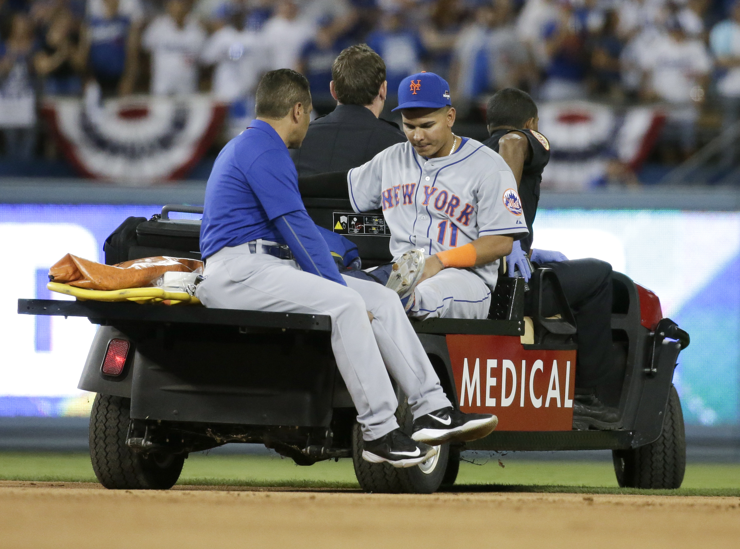 New York Mets shortstop Ruben Tejada is taken off the field after being hurt in a double play against the Los Angeles Dodgers during the seventh inning in Game 2 of baseball's National League Division Series, Saturday, Oct. 10, 2015 in Los Angeles. (AP Ph
