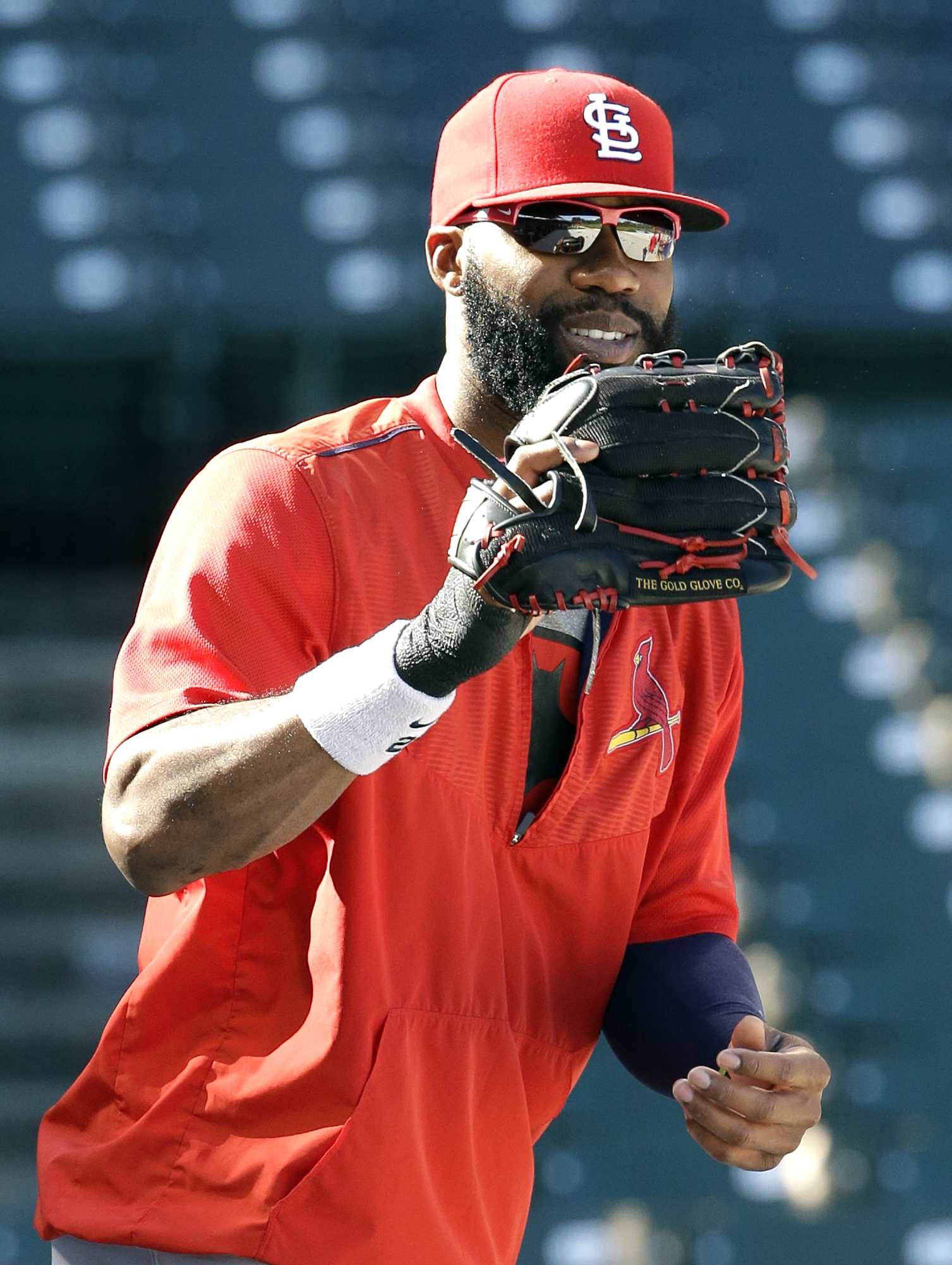 St. Louis Cardinals' Jason Heyward smiles as he waits for a ball during an NLDS baseball practice on Sunday, Oct. 11, 2015 in Chicago. The Cardinals will face the Chicago Cubs in Game 3 of the National League Division Series on Monday. (AP Photo/Nam Y. Hu